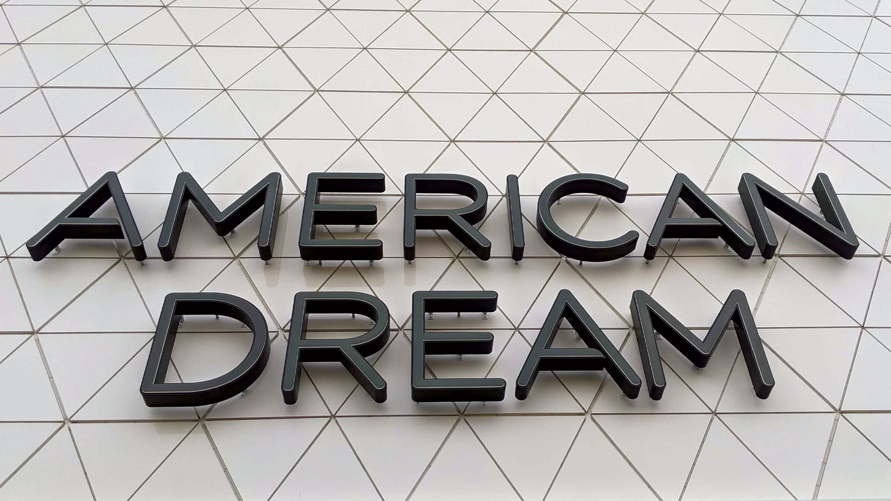 American Dream dimensional identity signage on building facade.