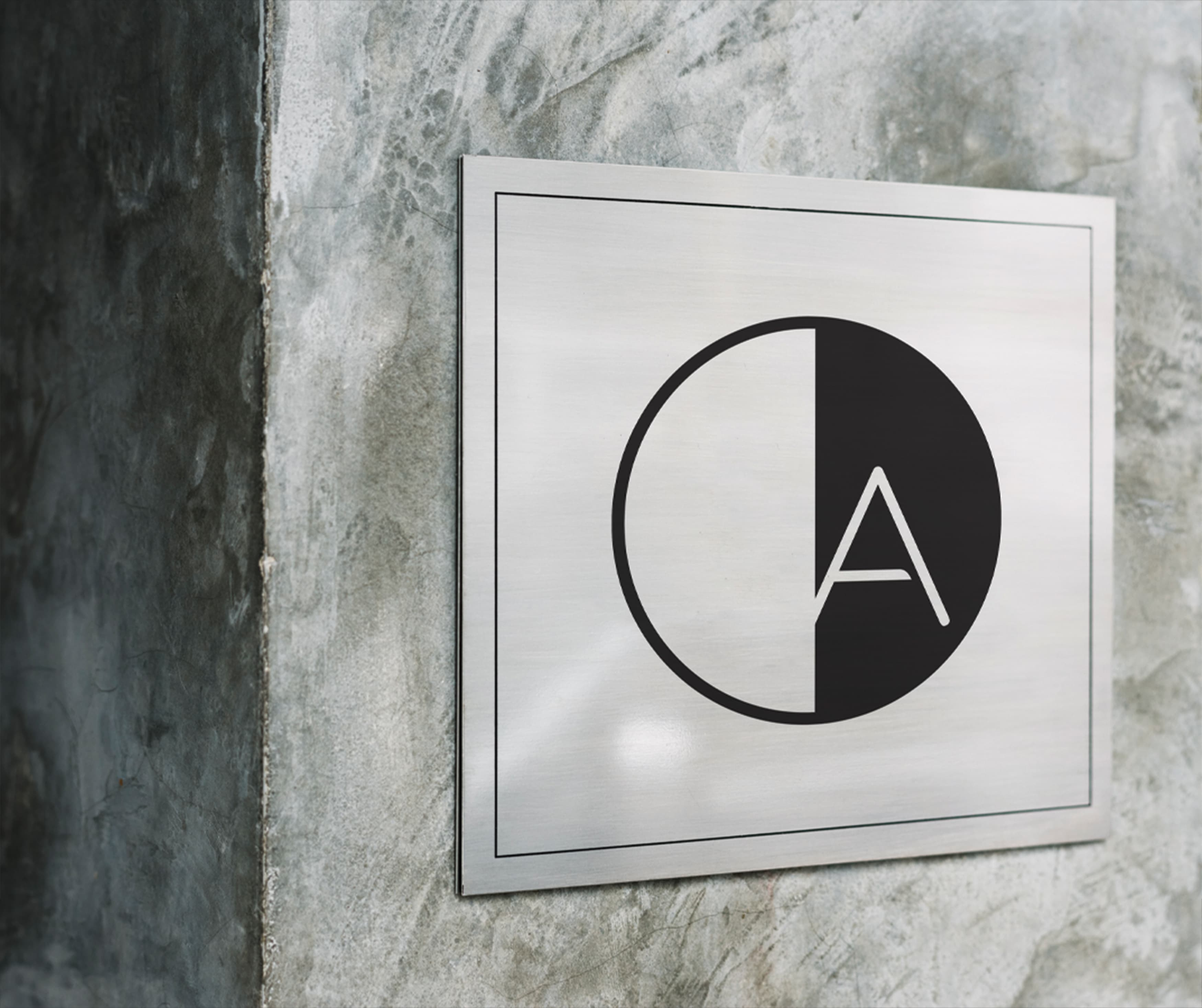 American Dream Retail Project Design in East Rutherford, New Jersey. Branded plaque sign identity.