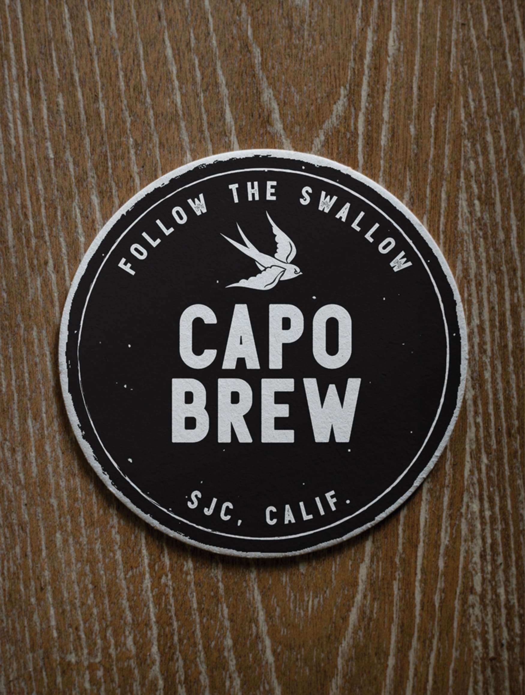 Capo Brew, a brewery located in the historic San Juan Capistrano, California, worked with RSM Design to craft a brand identity that conveyed its historic roots and cowboy personality. Branded coaster.