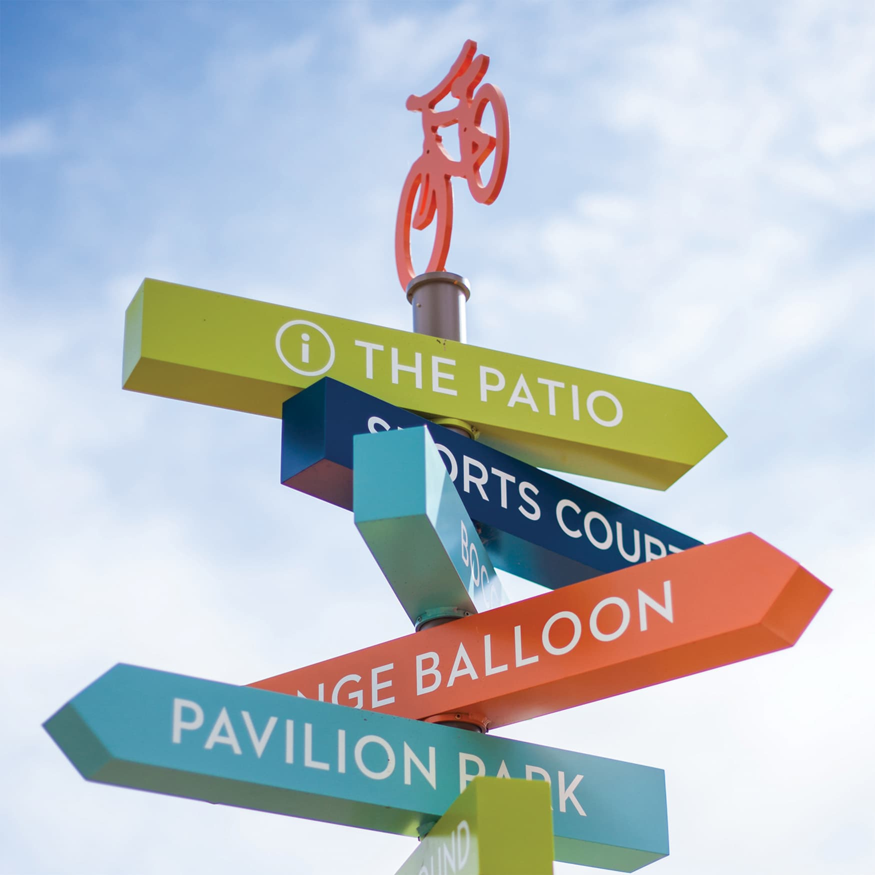 Fun, multi-colored flag directional wayfinding signage