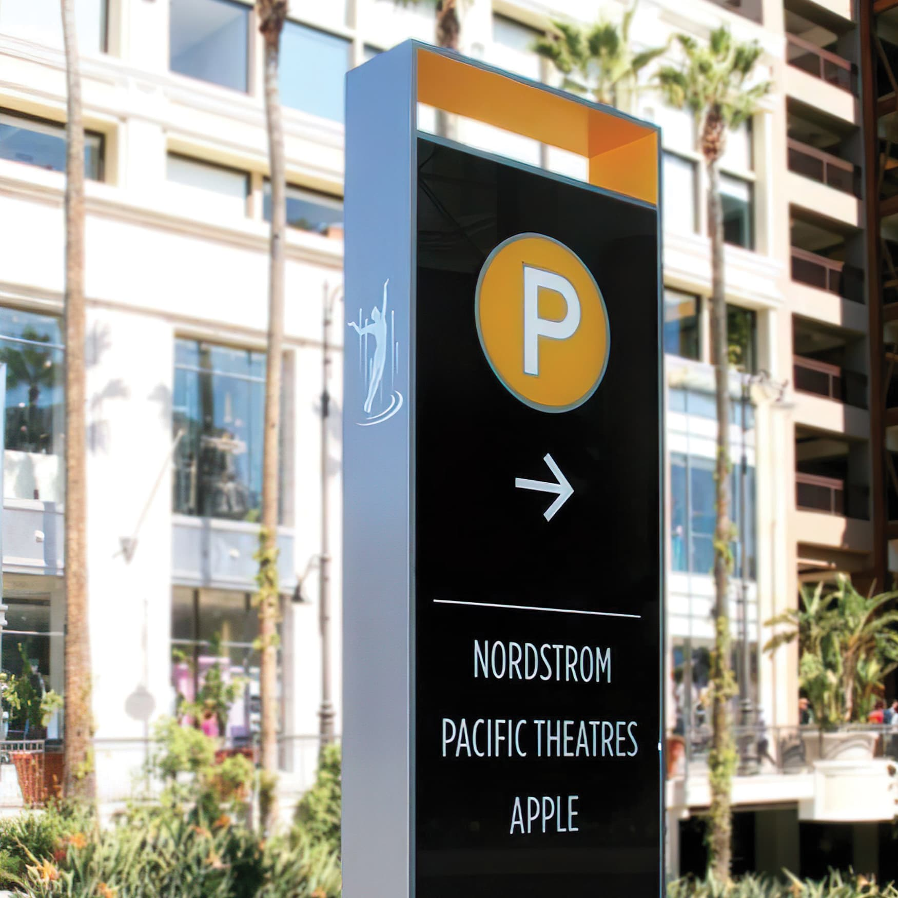 A close up of a directional sign located at the Americana at Brand.