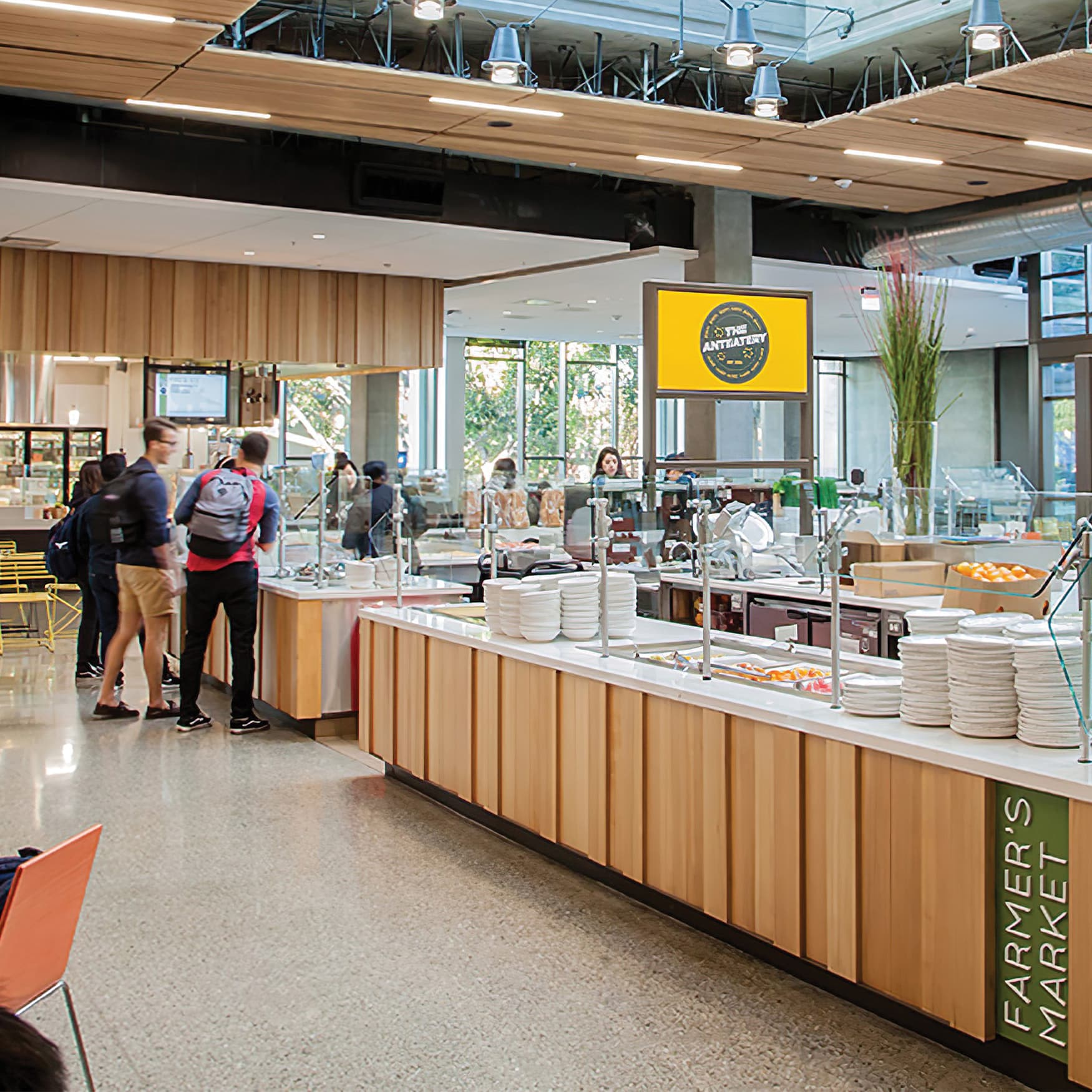 An interior photograph of the Anteatery Foodhall featuring a few signage elements.
