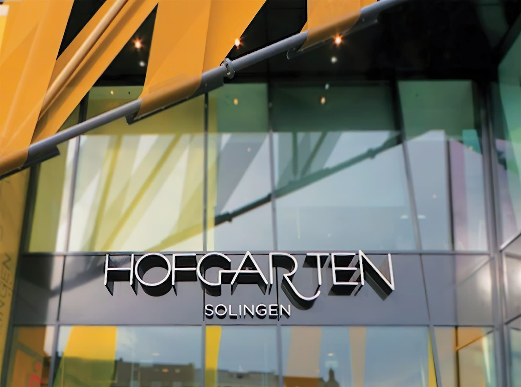 Hofgarten, a retail project in Solingen Germany, project identity illuminated signage design.