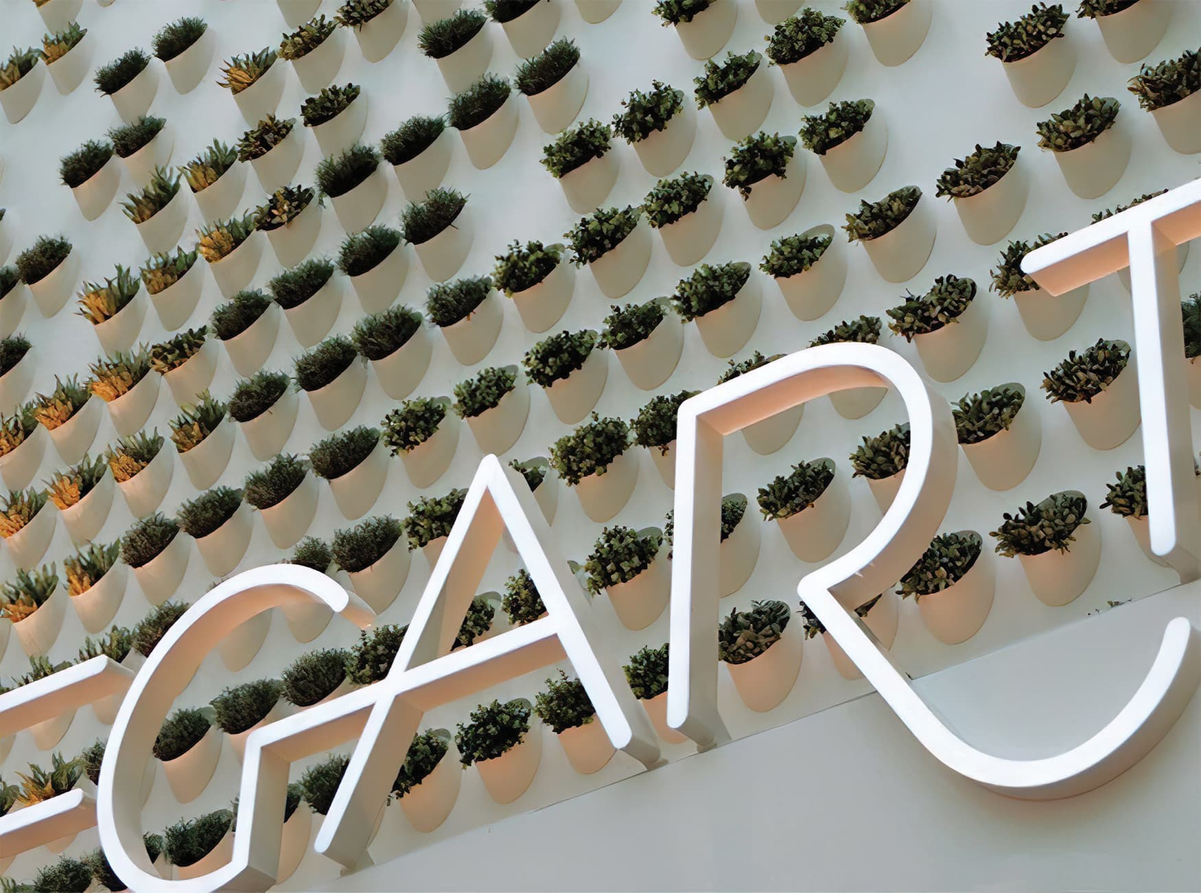 Hofgarten, a retail project in Solingen Germany, living wall integrated with project identity signage.