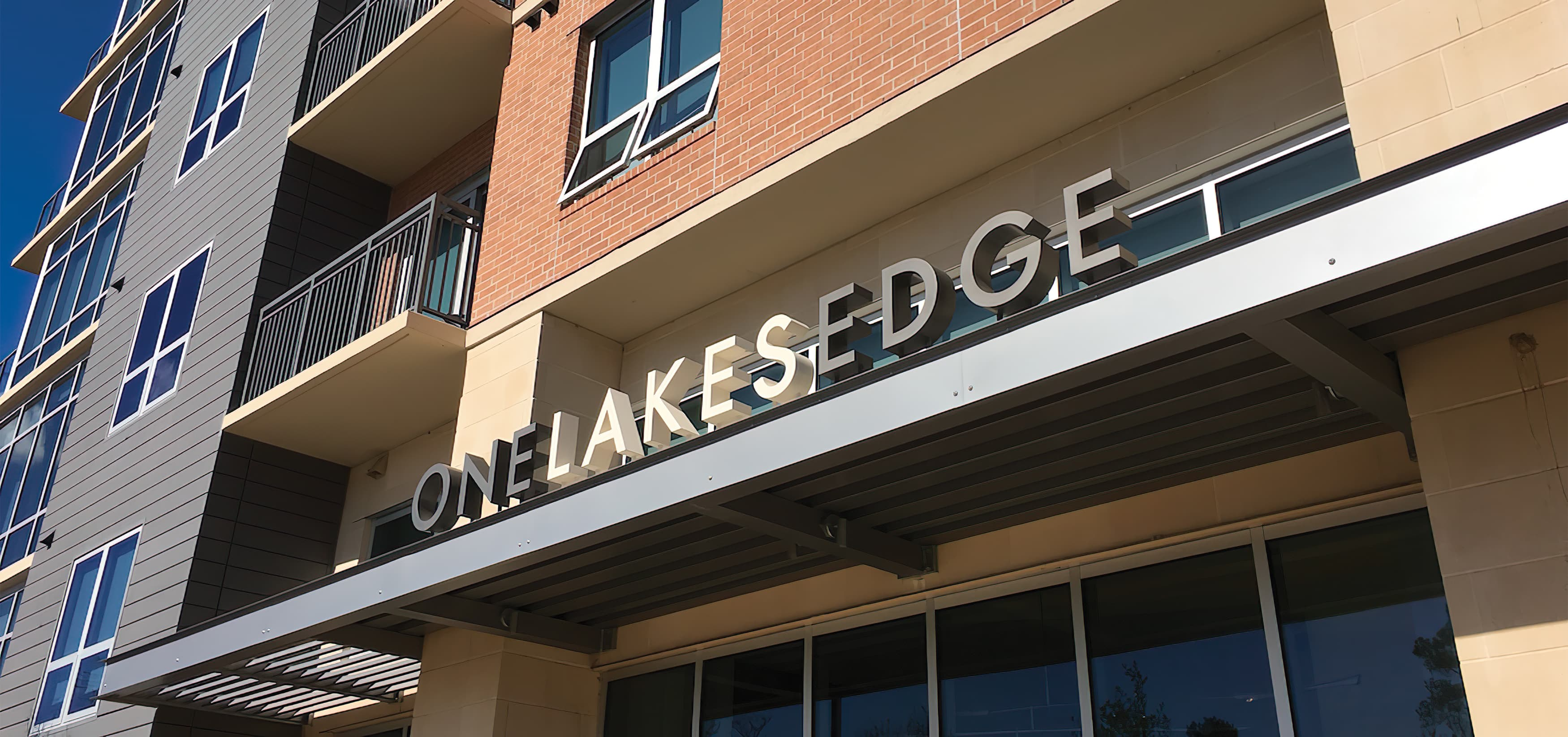 Hughes Landing, a mixed-use development in  The Woodlands, Texas. Building Signage. Project Signage. Canopy Signage.