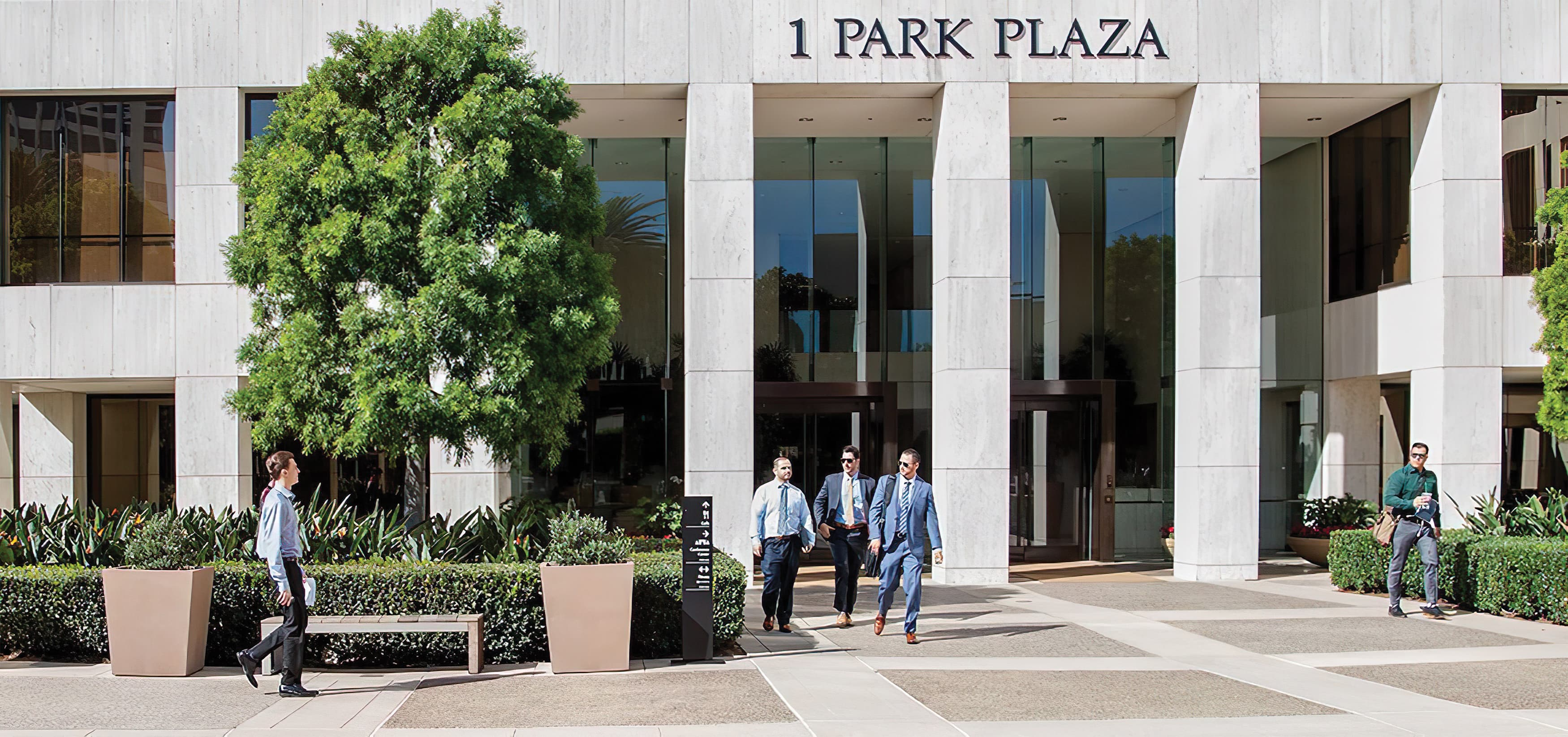 1 Park Plaza, an Irvine Company workplace, with a project identity signage integrated into the architecture.