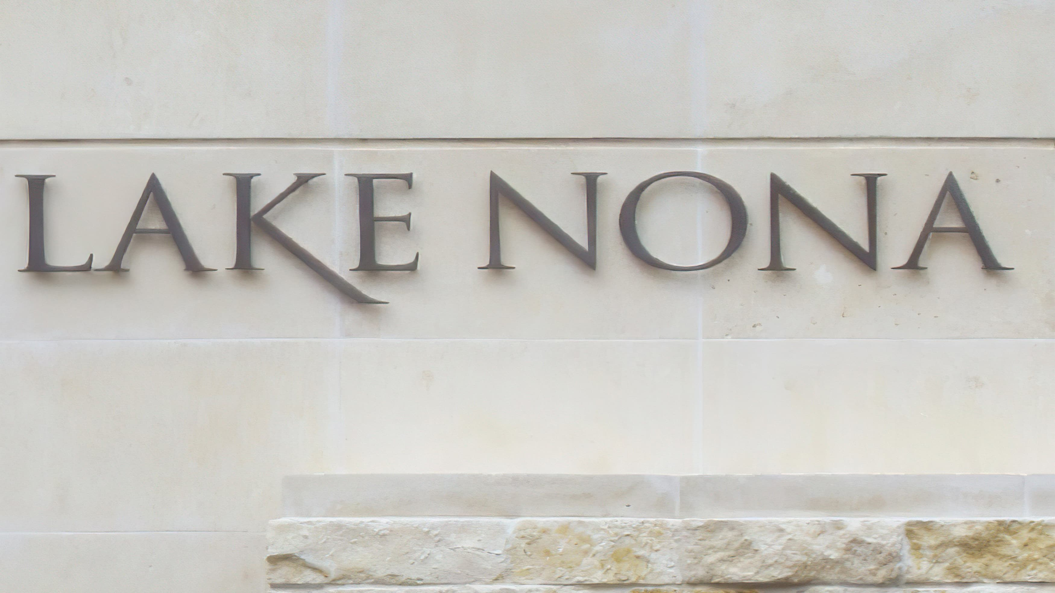 Dimensional Lake Nona brand identity applied to limestone monument