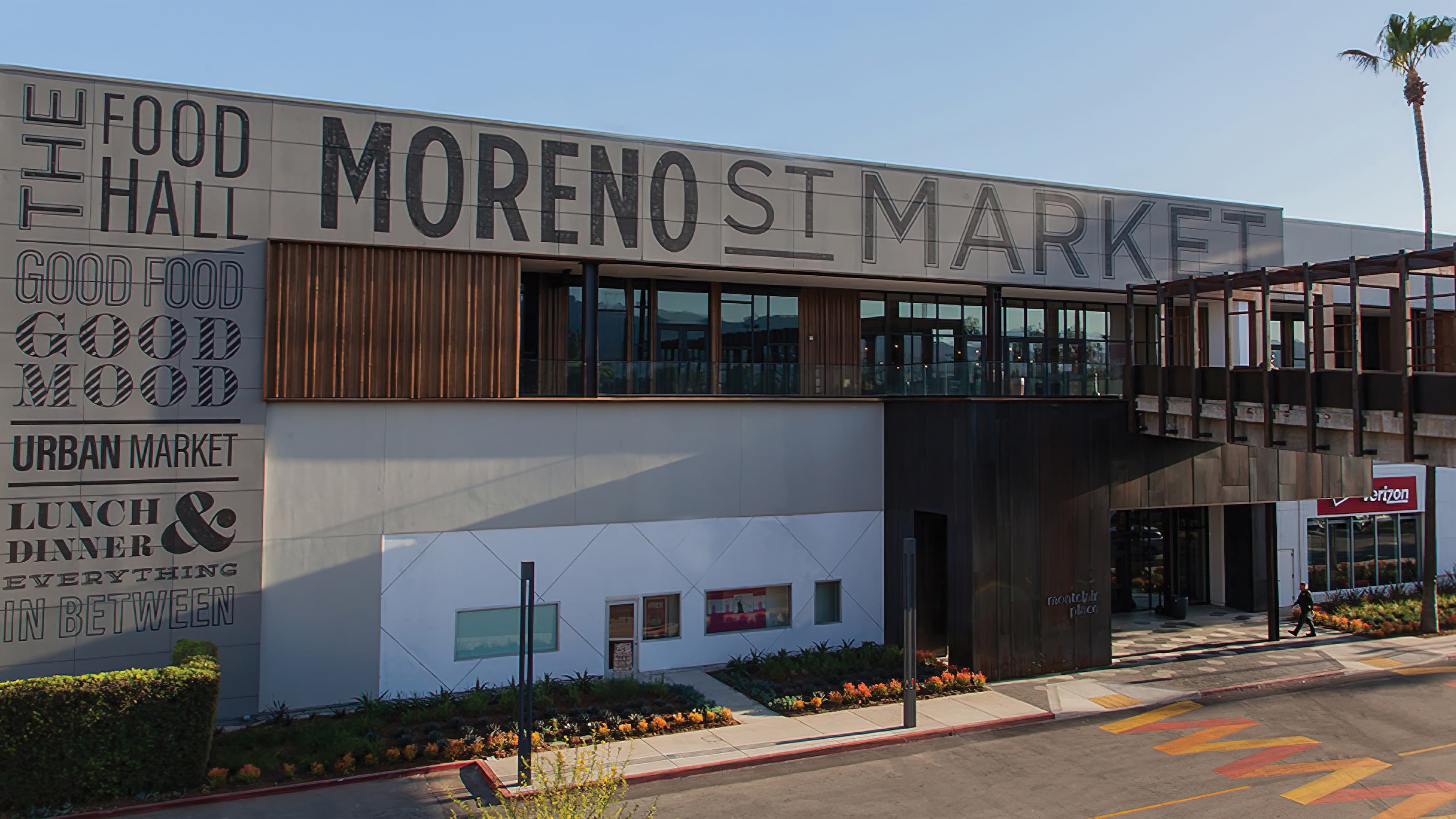 Moreno Street Market building with architectural graphics and specialty crosswalk