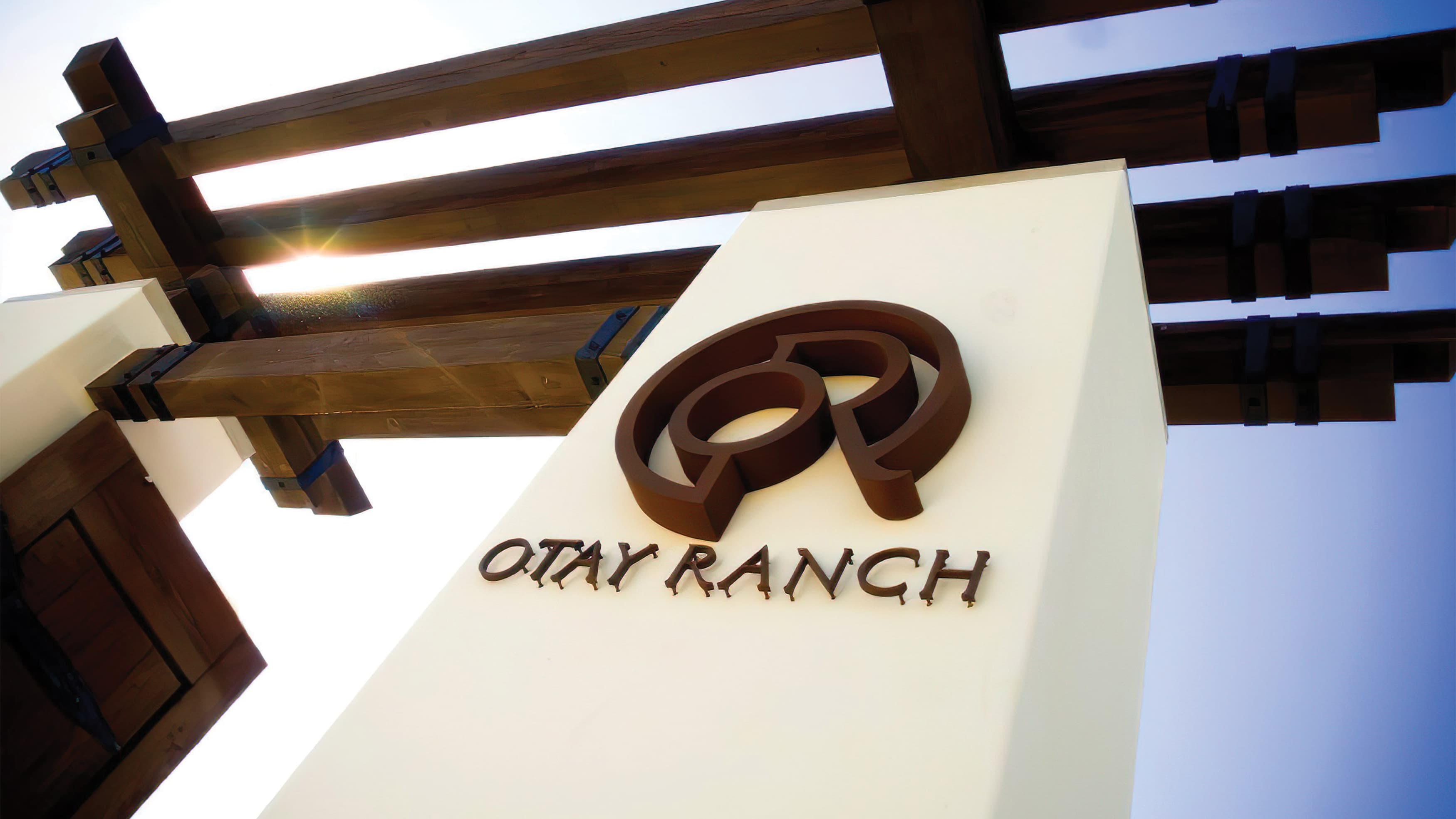 Otay Ranch corten metal identity fastened to Spanish-style column