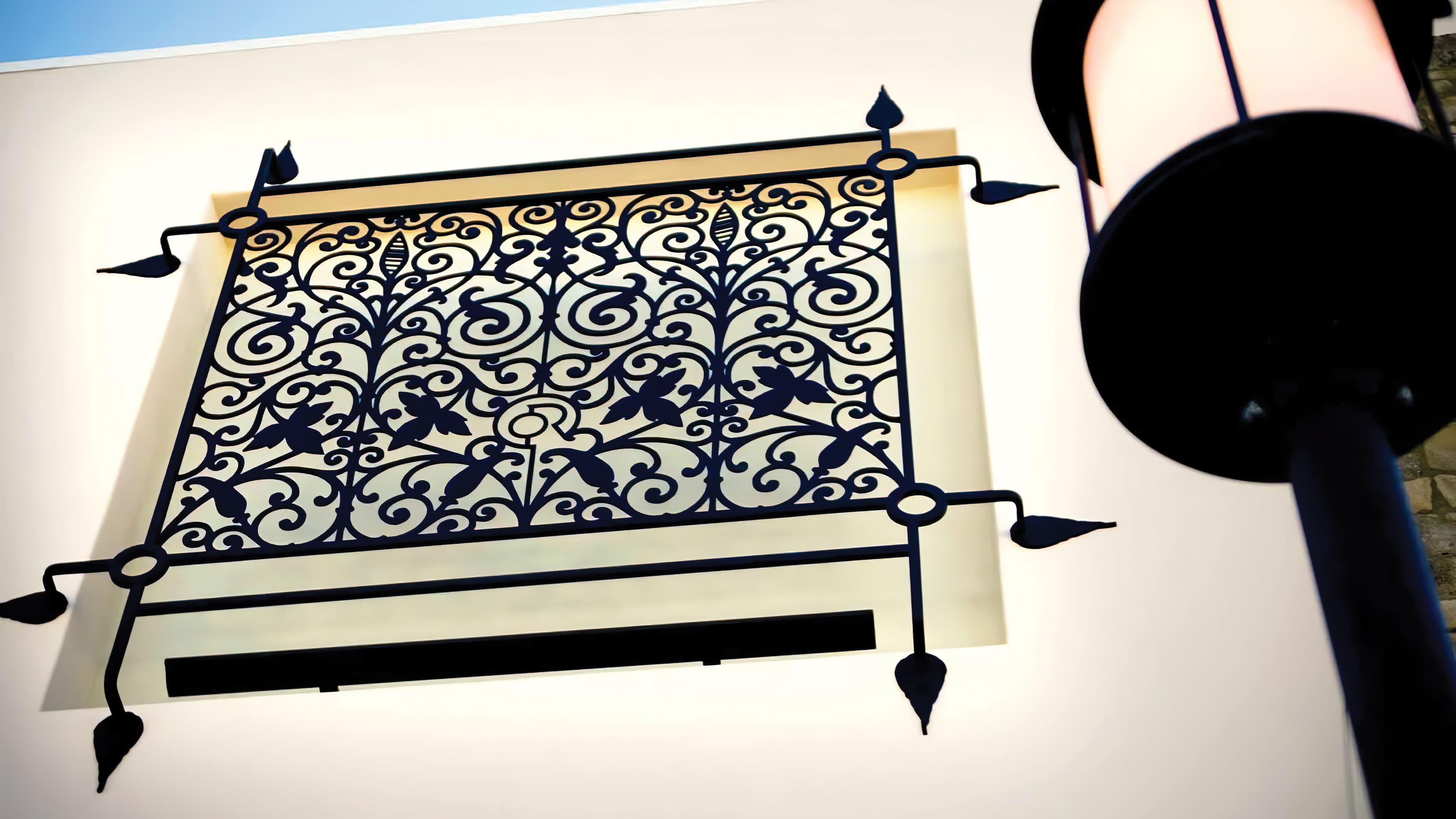 A patterned architectural grille feature, a piece of the public art program by RSM Design