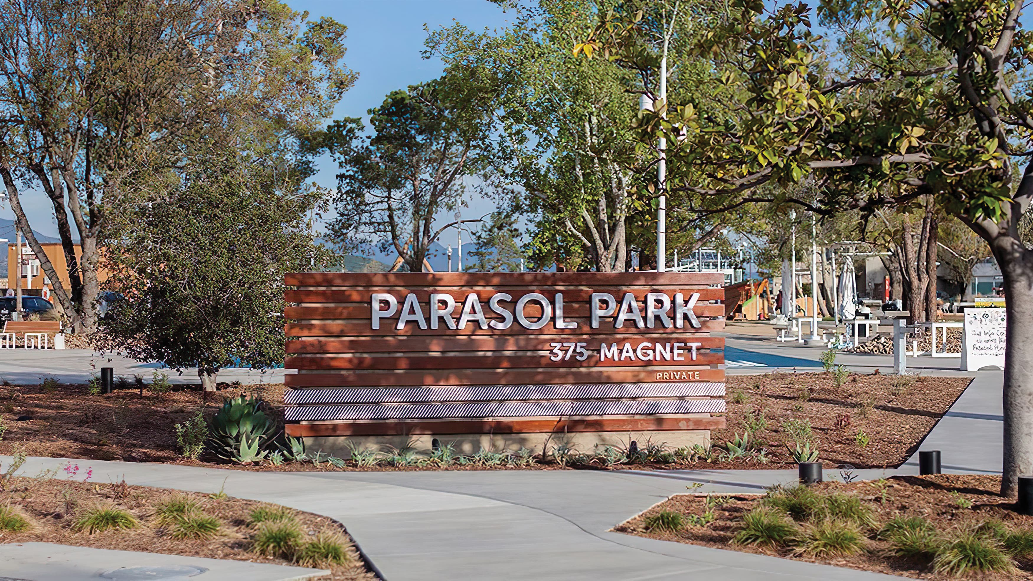 Parasol Park horizontal, wooden-slat sign identity integrated into the landscape