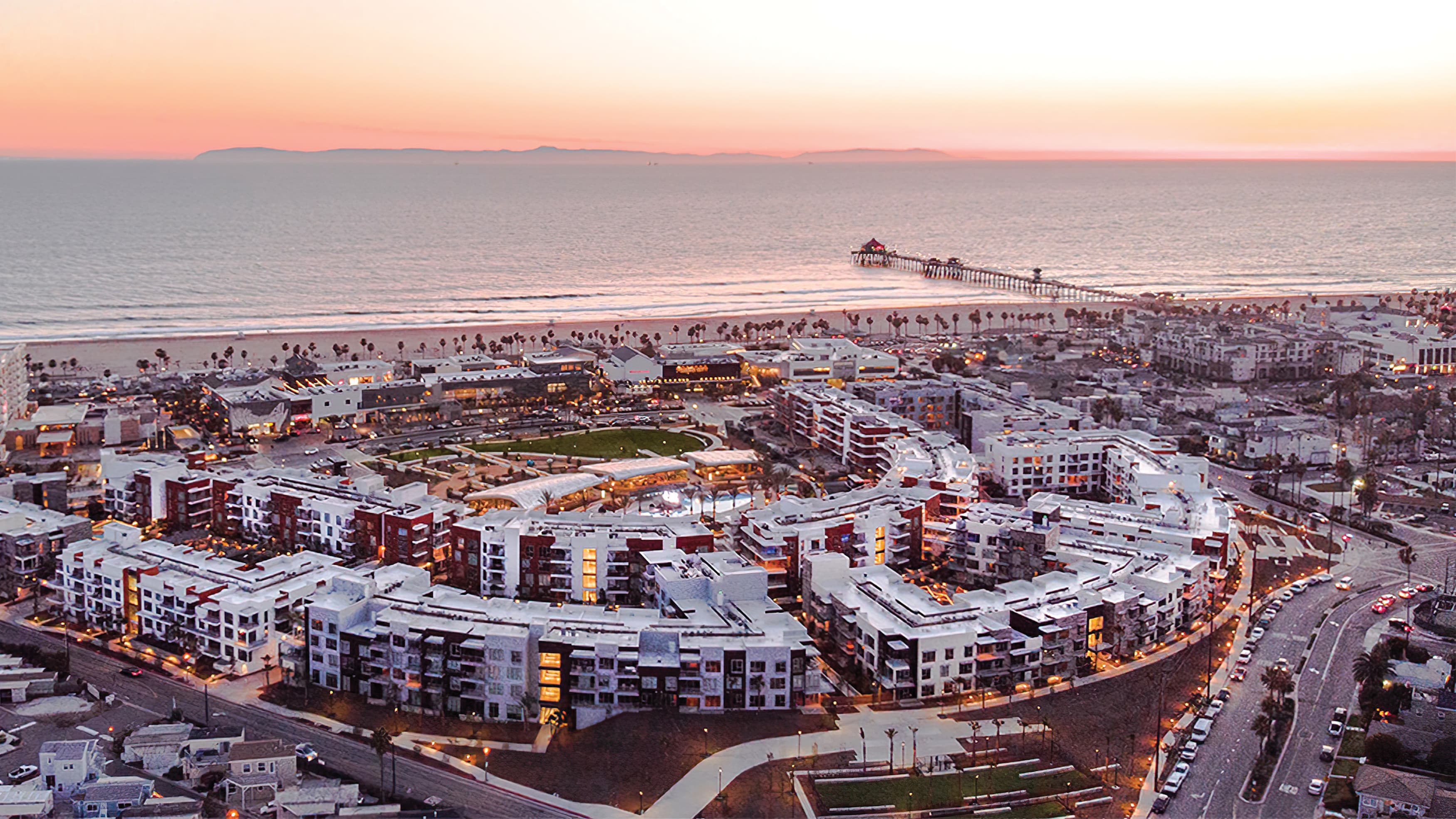 Aerial view of the Residences at Pacific City and ocean at sundown