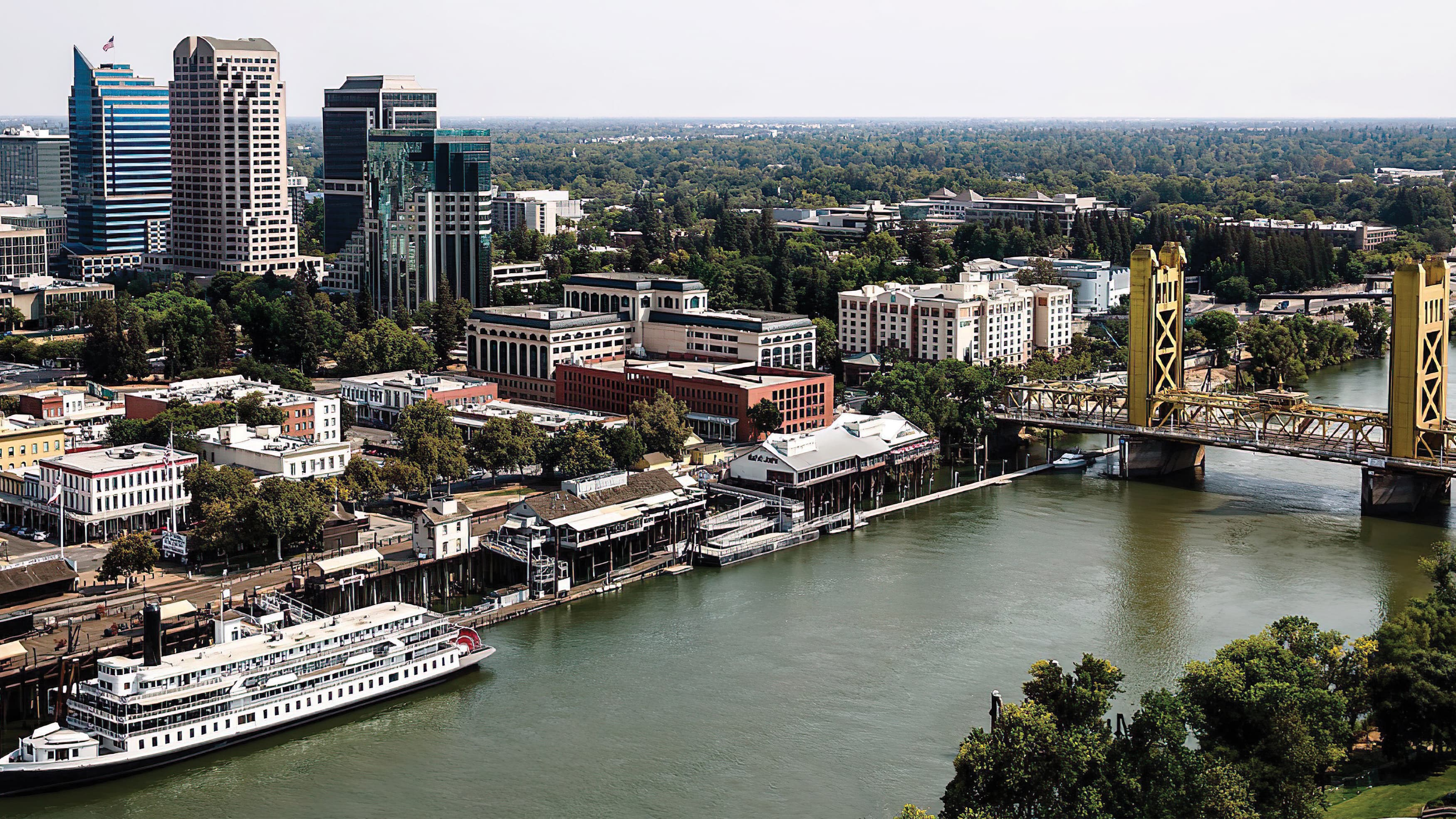 Aerial view of the famed Sacramento waterfront and its golden bridge
