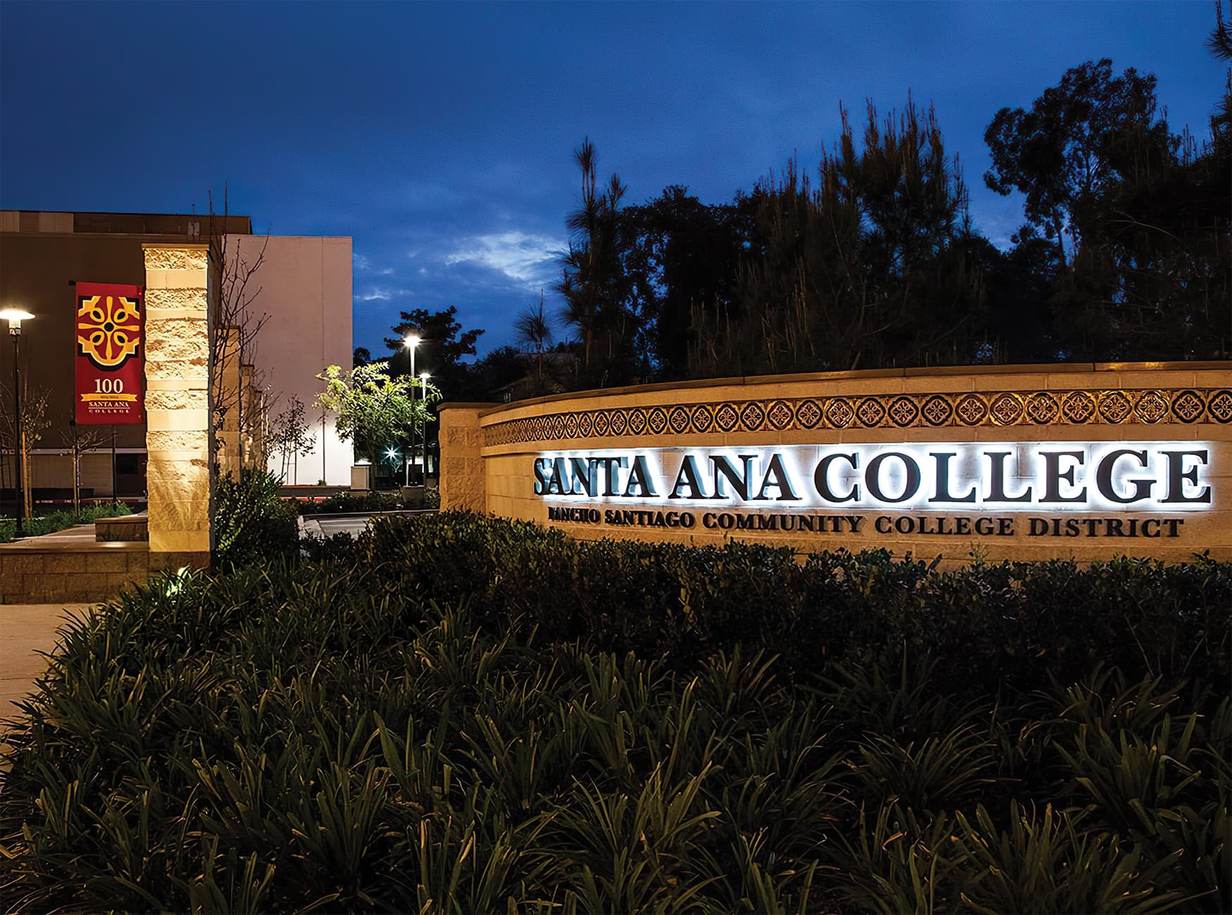 RSM Design worked with Santa Ana College to create a wayfinding system and public art system for the higher-education campus. Illuminated Project Identity on Landscape Wall.