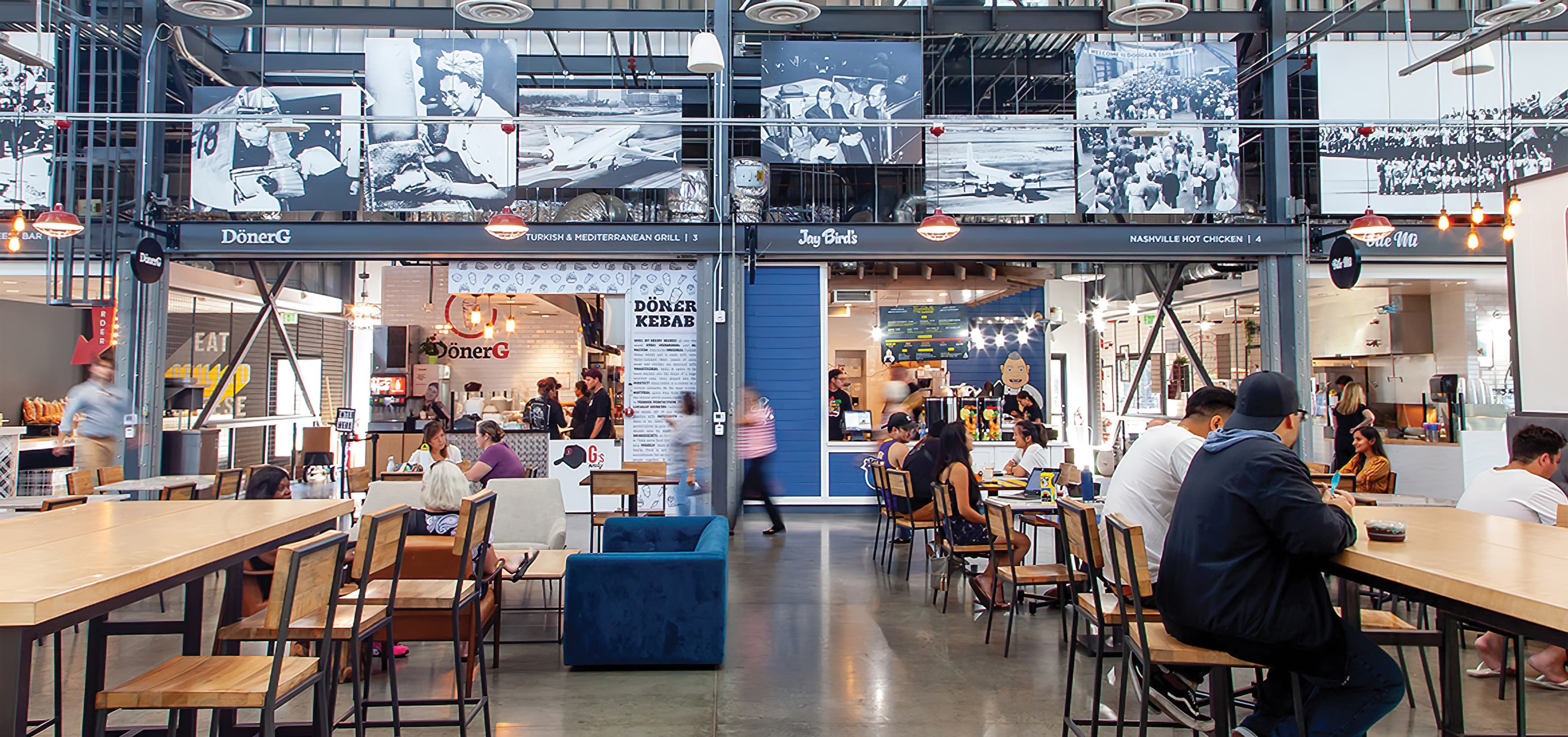 The Hangar, a food hall dining complex at Long Beach Exchange.  Menu Signage. Food Hall Design.