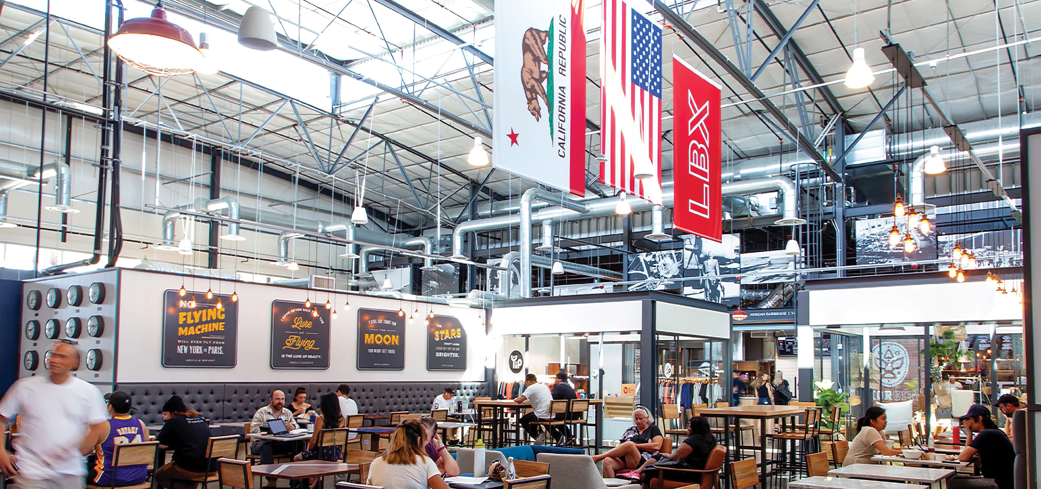 The Hangar, a food hall dining complex at Long Beach Exchange. Environmental Graphic Design.