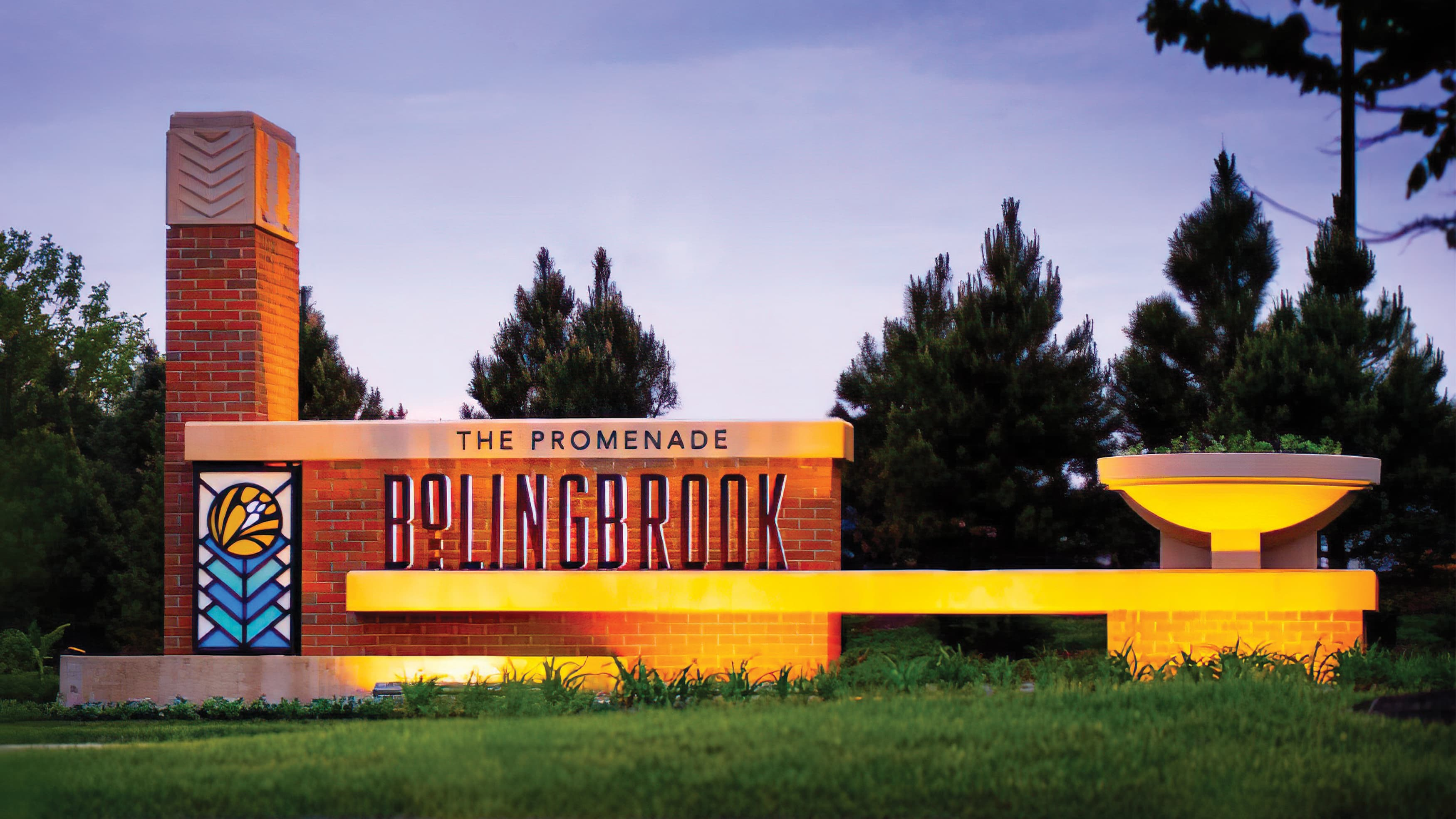Architectural brick wall featuring Bolingbrook identity at dusk