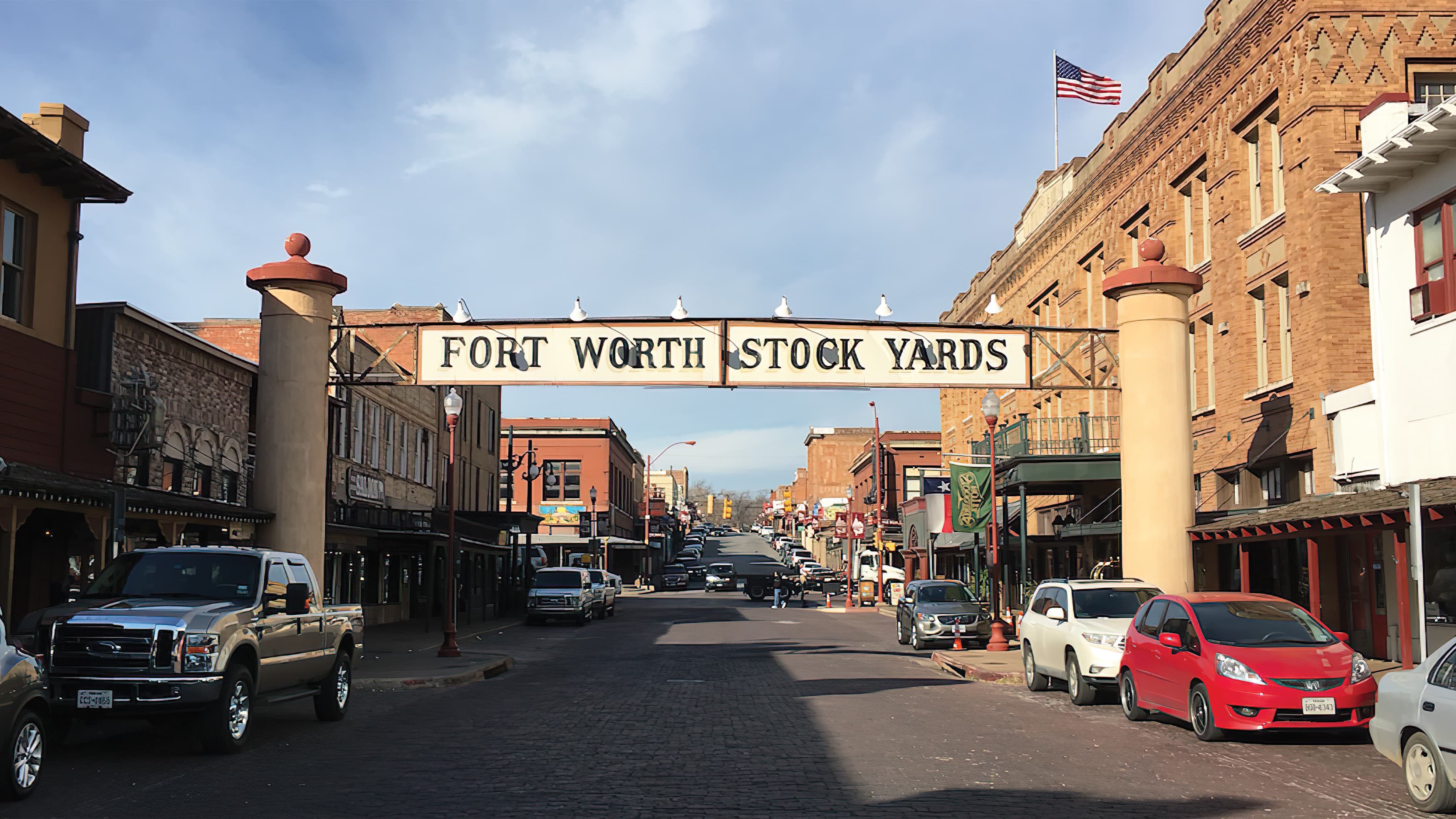 historic-style Fort Worth Stock Yards gateway identity spanning over street