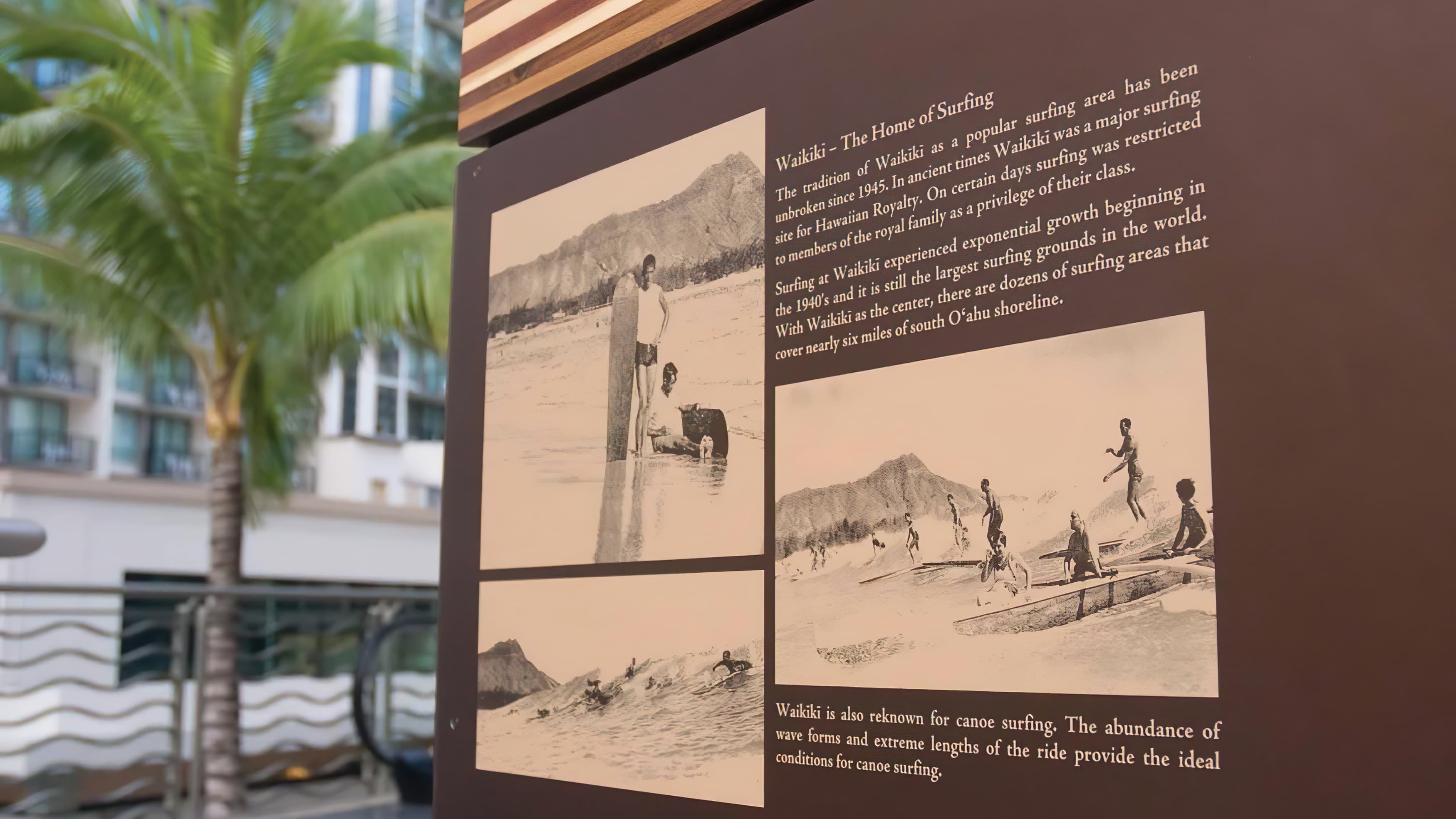 A close-up photo of an interpretive sign panel located in downtown Waikiki.