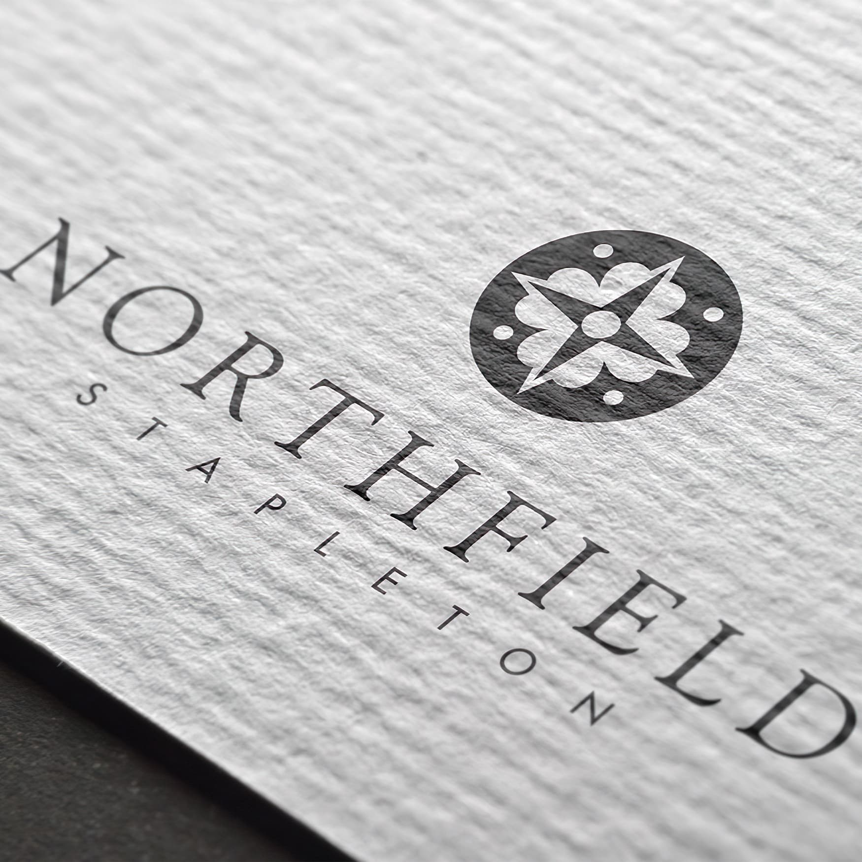 Close up of Northfield Stapleton logo applied to textured stationary