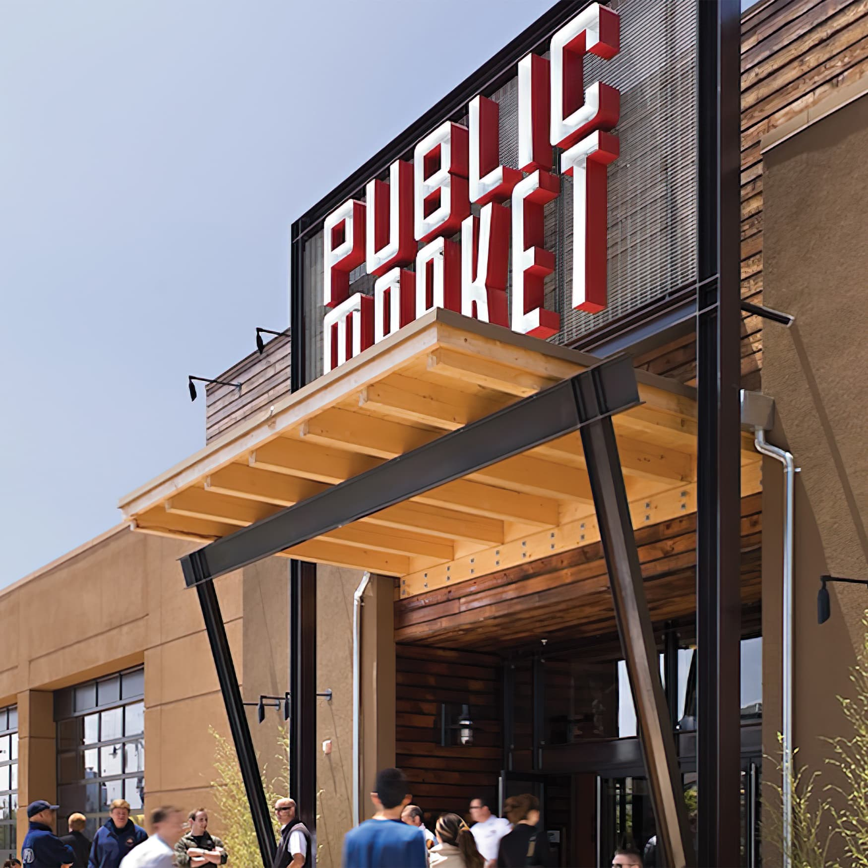 Industrial-styled market entrance with dimensional sign identity