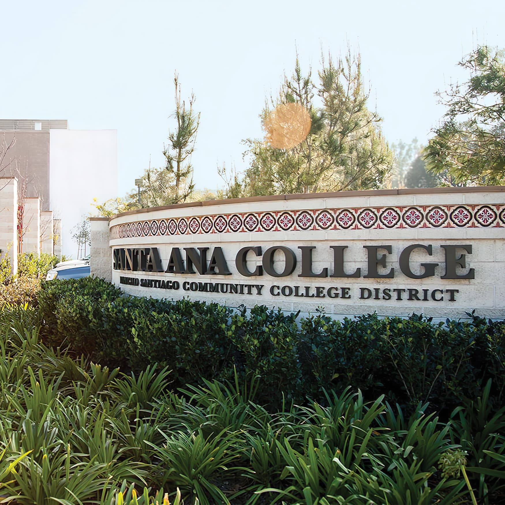 Wall with tiled accents featuring Santa Ana College dimensional letter identity