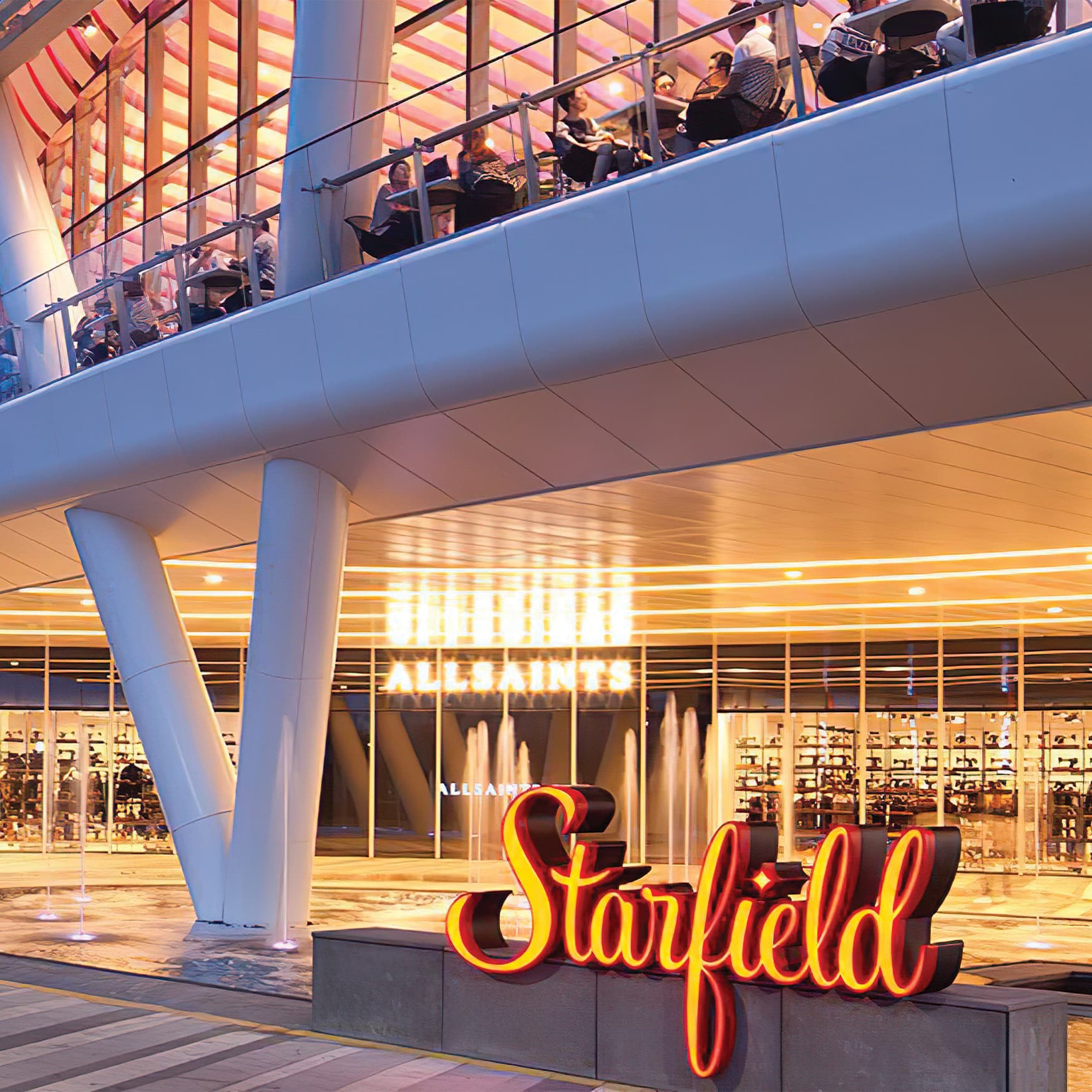 Shopping mall entrance with orange placemaking identity signage