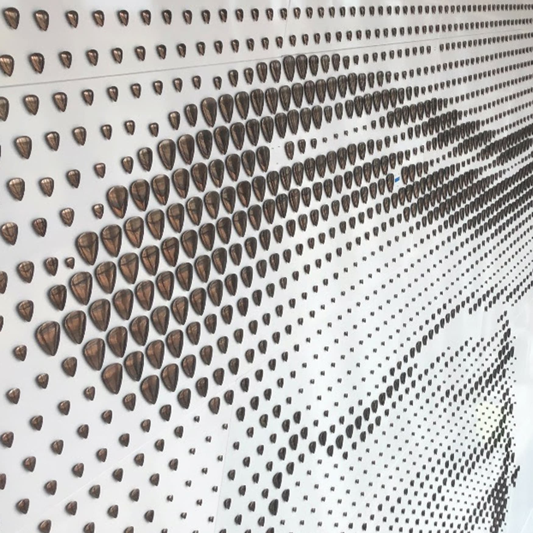 Detail of guitar pick installation on donor wall of Buddy Holly Hall in Dallas, TX
