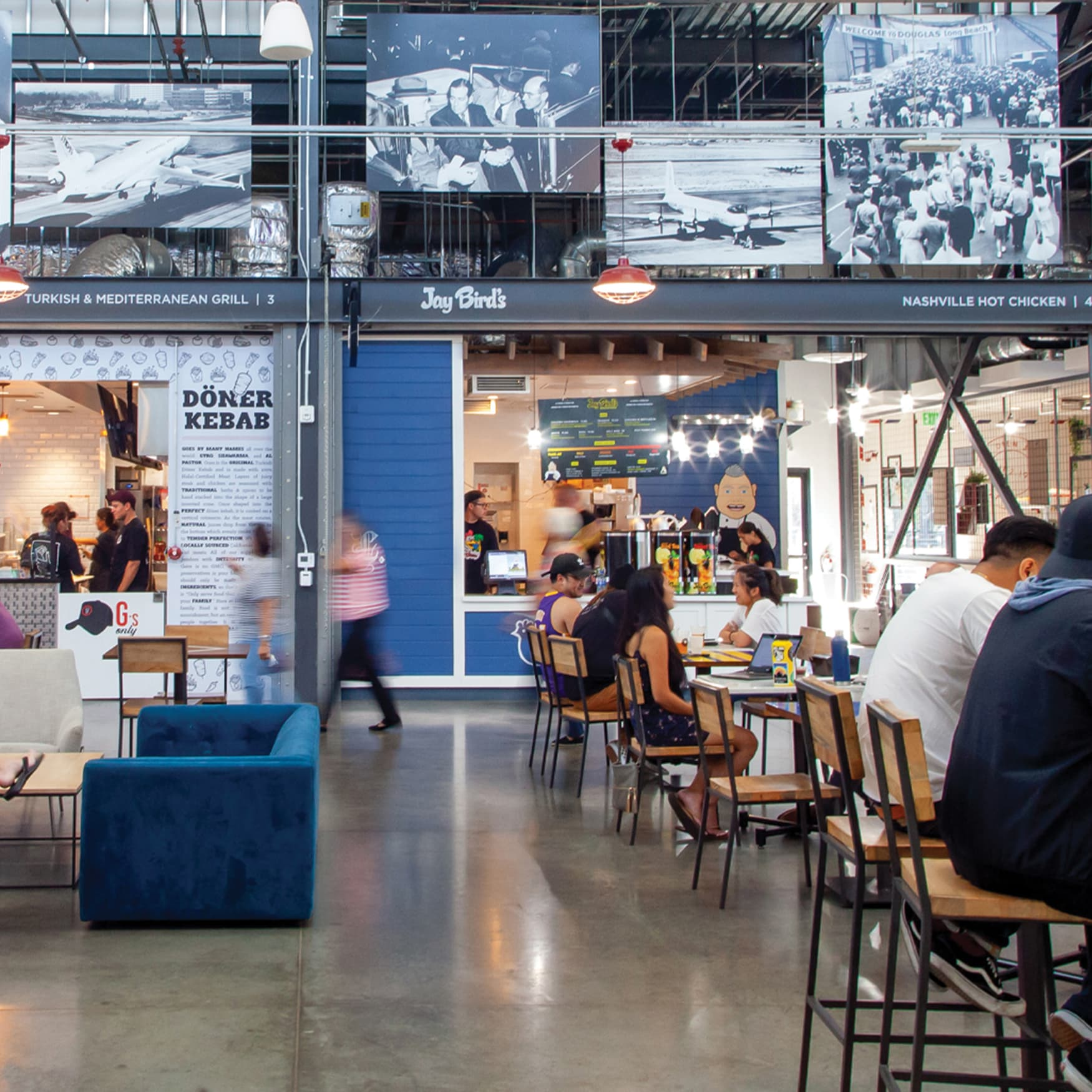 The Hangar food hall in Long Beach with open tables and multiple tenants