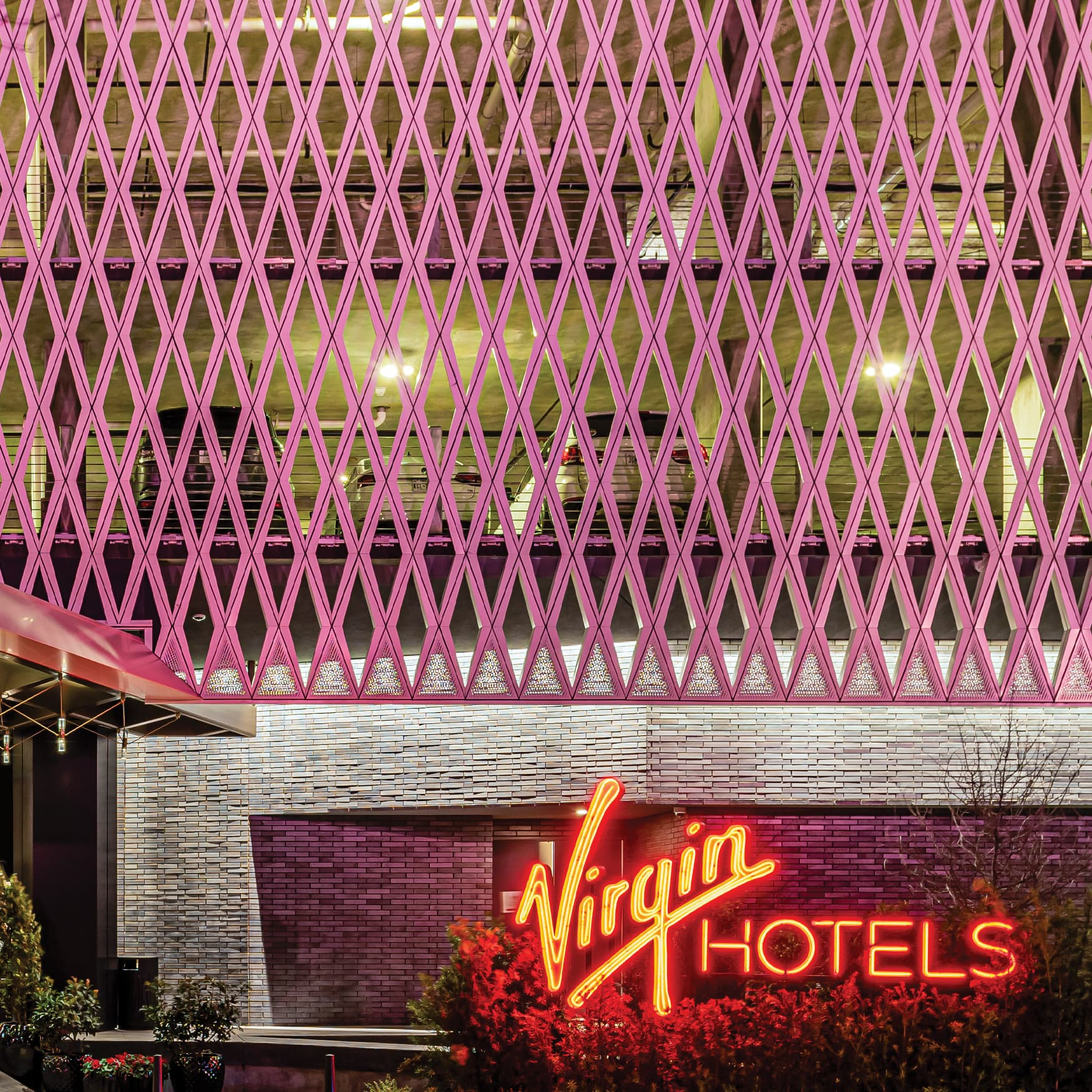 Neon monuments signage and parking garage facade design at Virgin Hotels in Dallas, TX