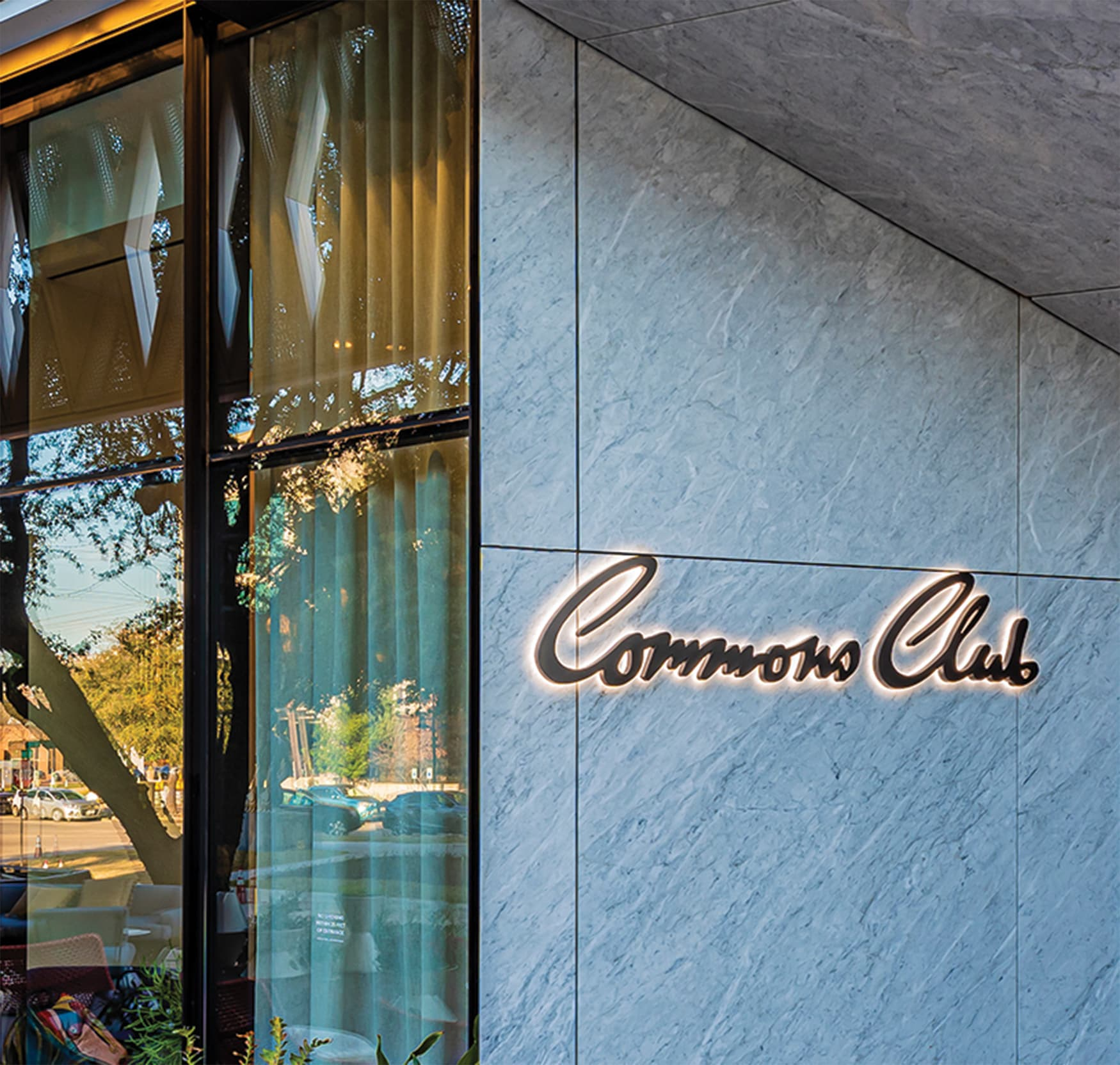 Commons Club at Virgin Hotel Dallas signage with halo illumination.