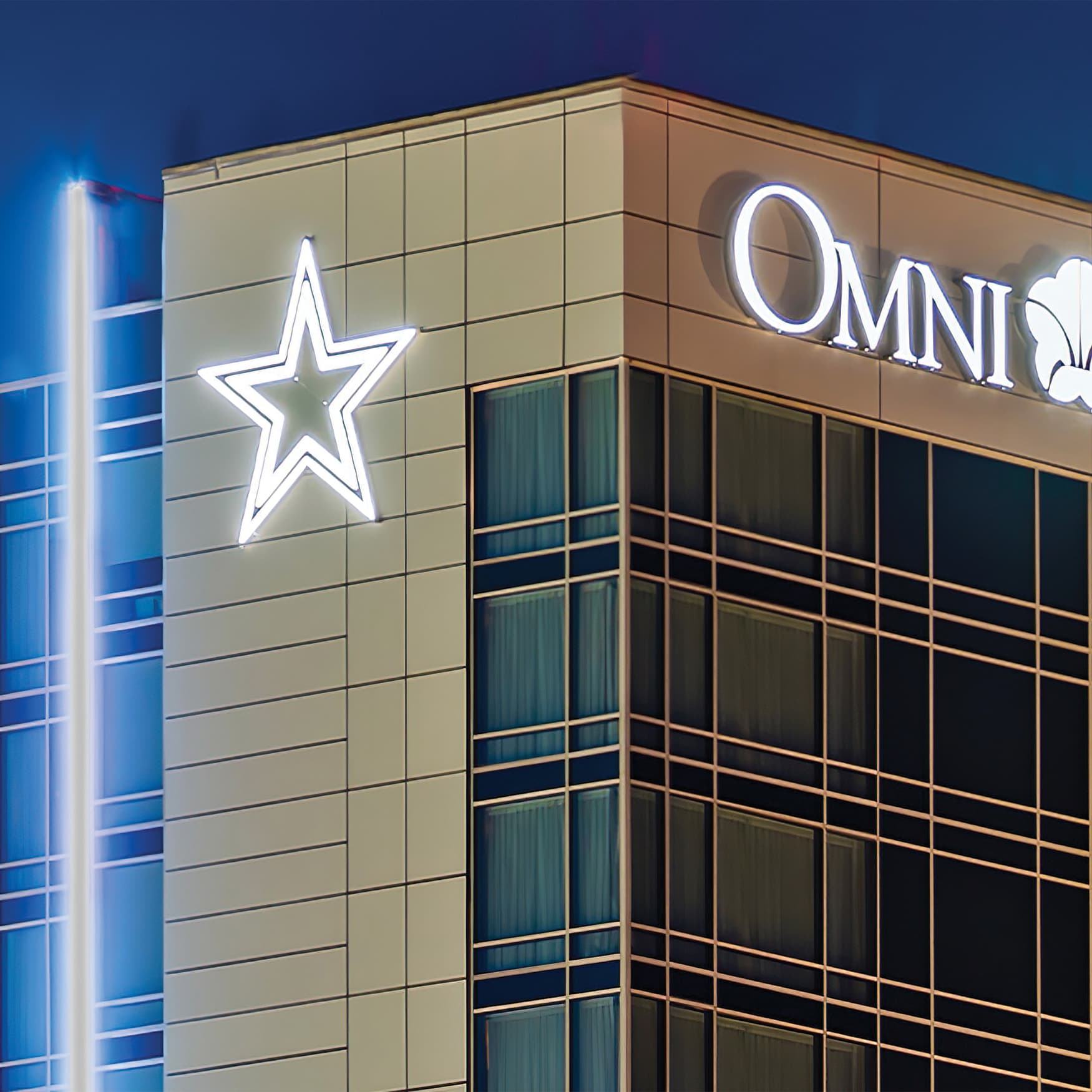The Omni Hotel, located in Frisco, Texas, at night time with illuminated signage.