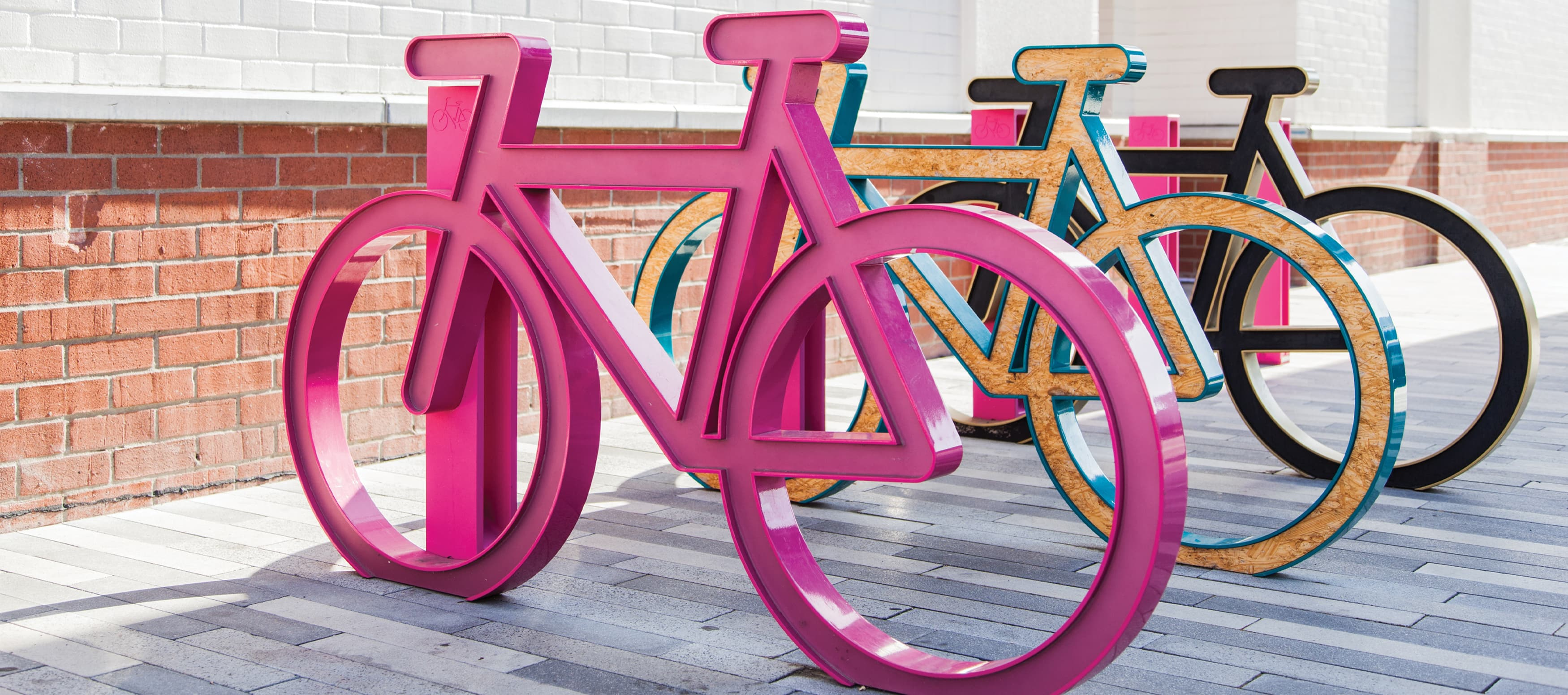 A fun pink and colorful bike rack