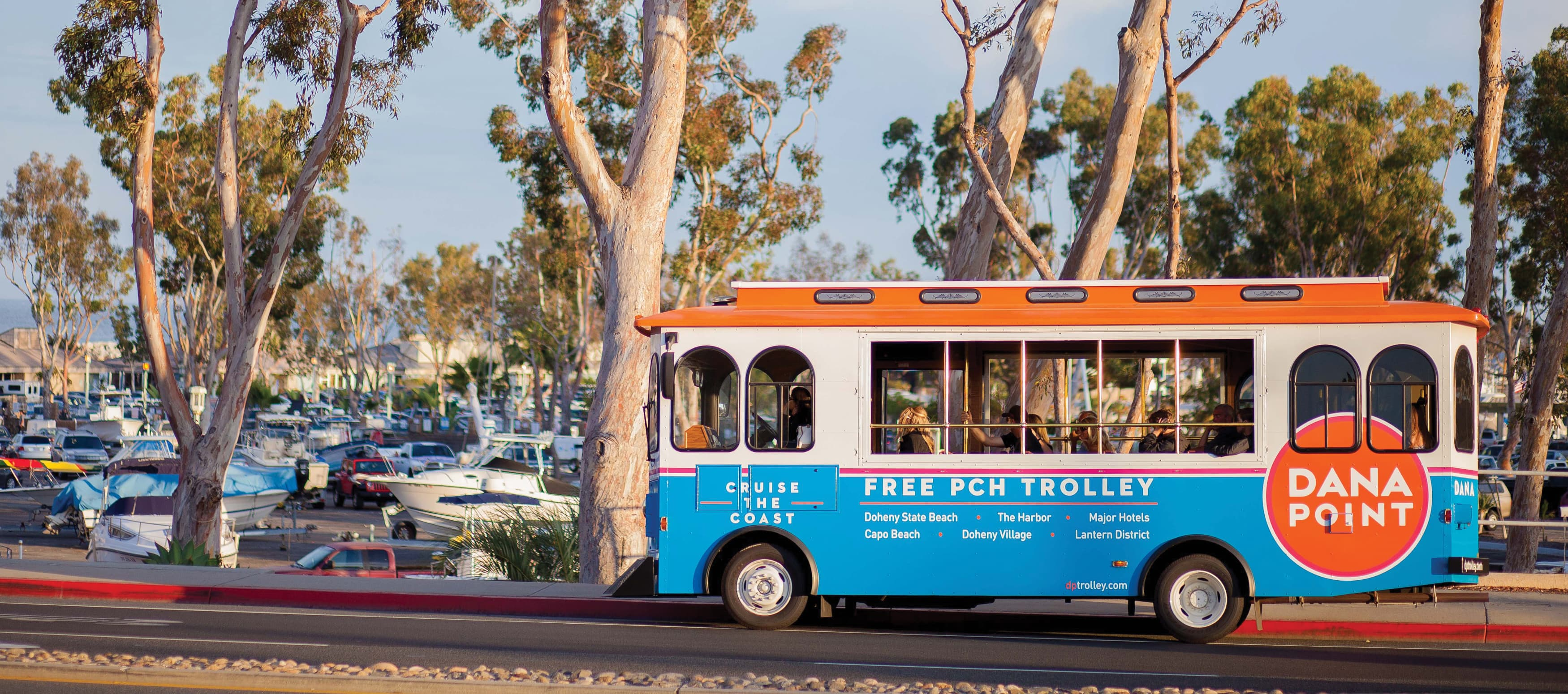 Dana Point public city trolley with orange and blue desIGN