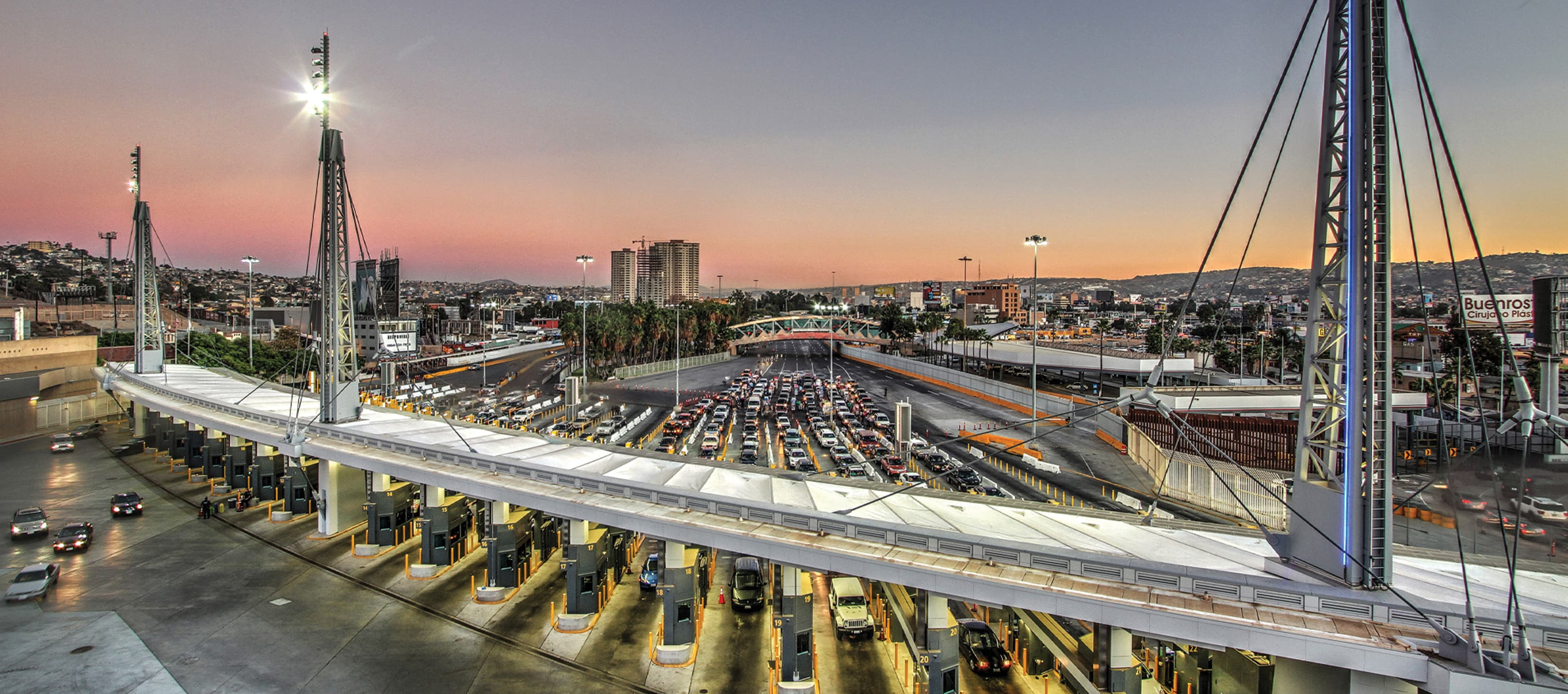 San Ysidro port of entry overhead view with cars lined up and sunset in the background