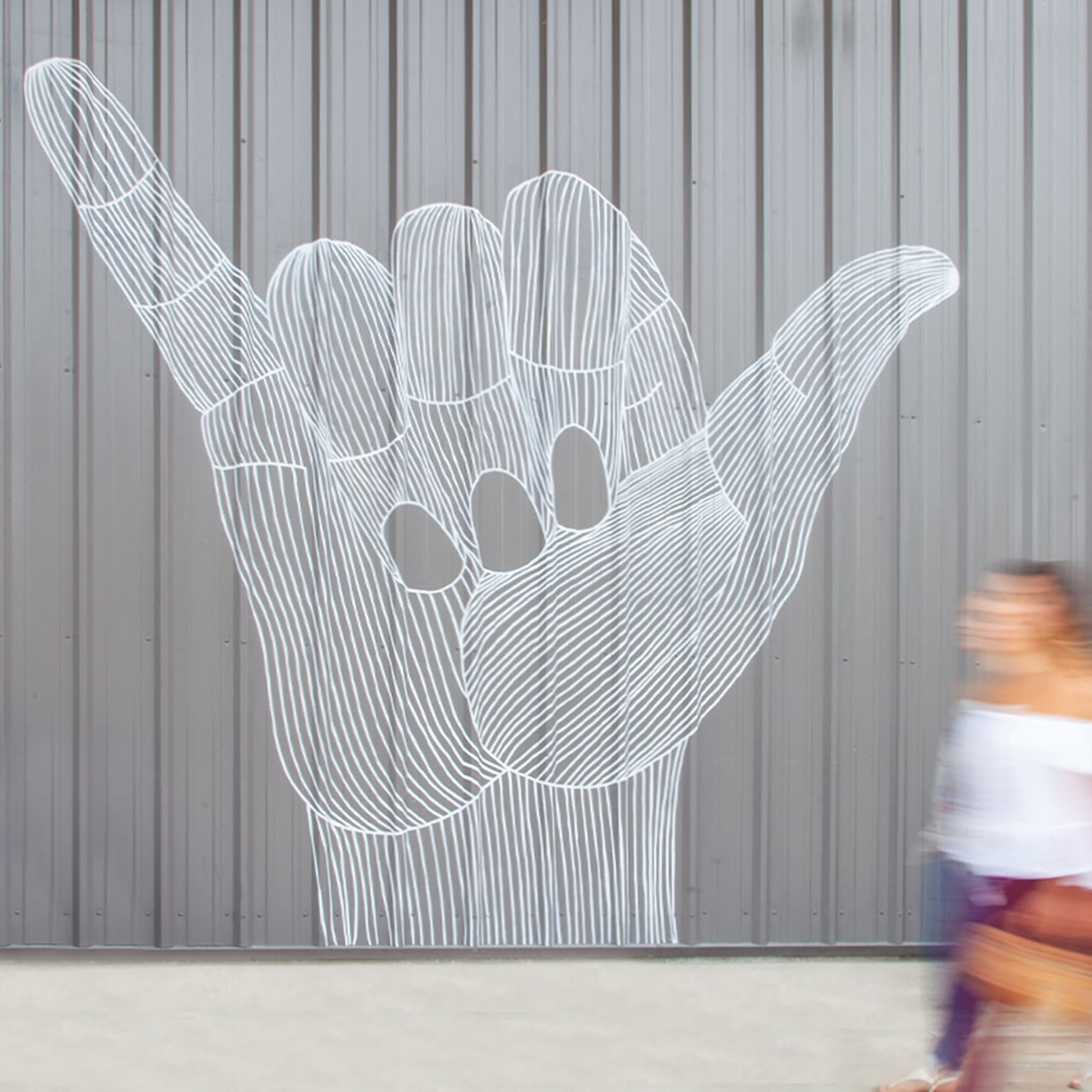 Public Art Specialty Graphic Mural of shaka hand on corrugated metal wall