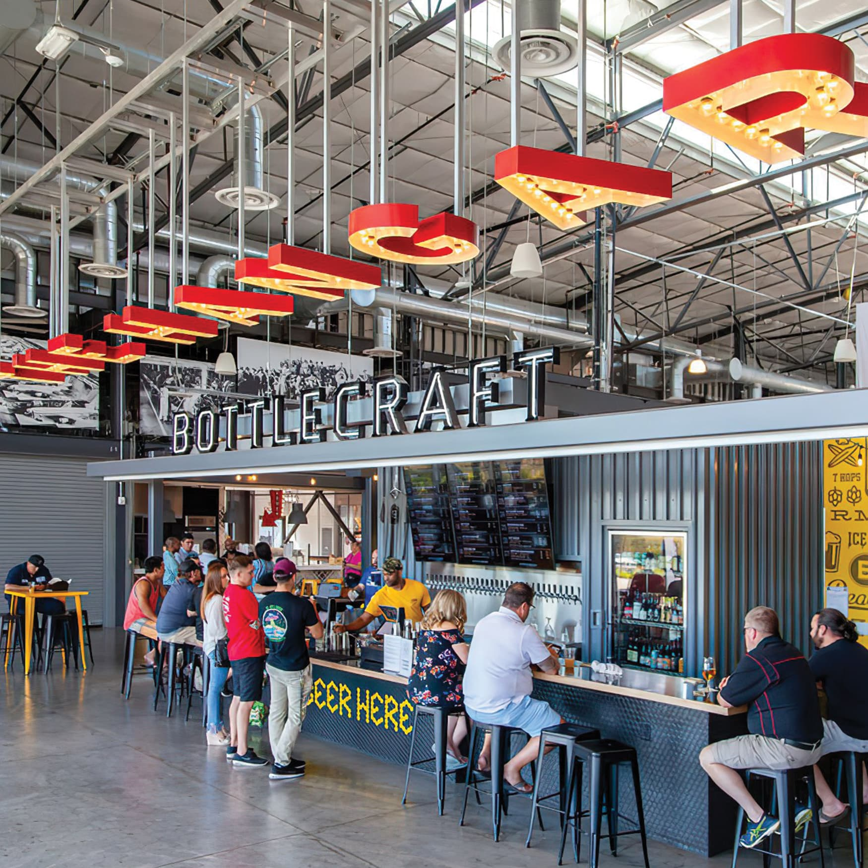 A photograph of signage inside The Hangar, a foodhall located at The Long Beach Exchange
