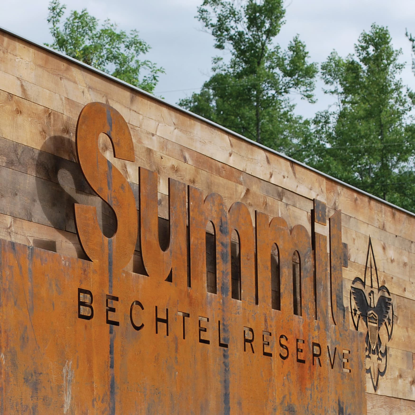 Corten and wood Summit Bechtel Reserve monument signage in West Virginia