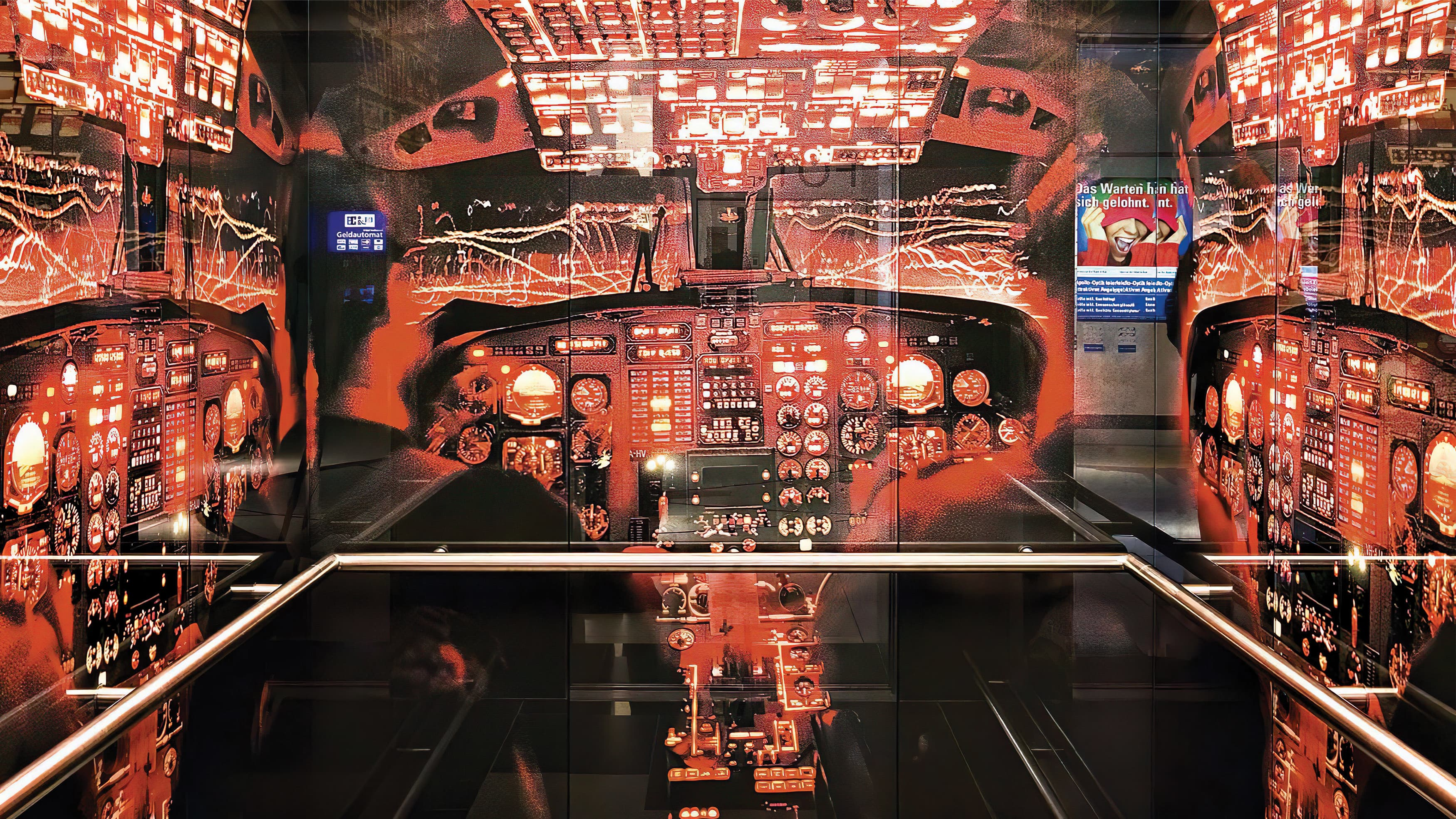 Interior of an elevator with plane cockpit graphics.