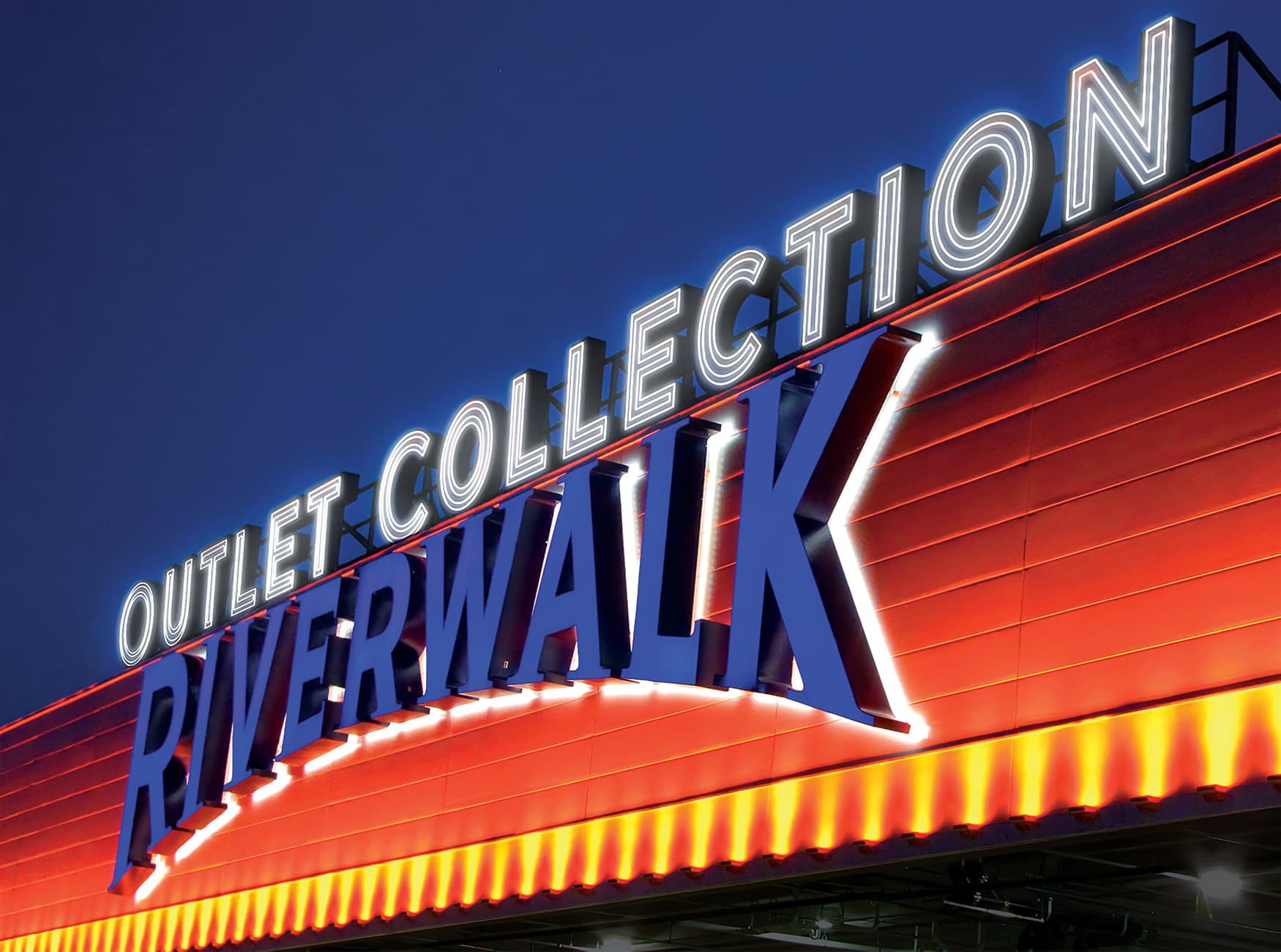 The Outlet Collection at Riverwalk. Face-Illuminated Rooftop Signage. Project Identity Signage.