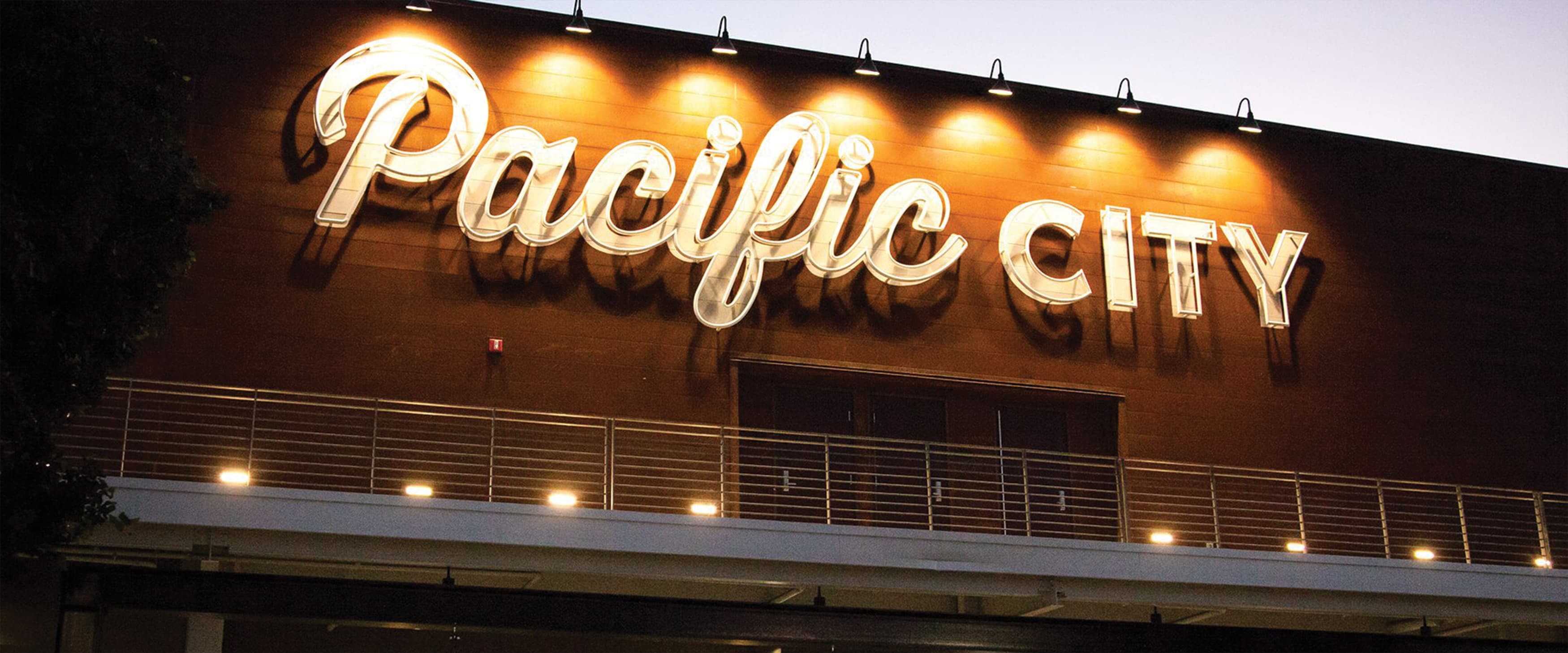 A large painted and exposed neon identity sign at Pacific City.