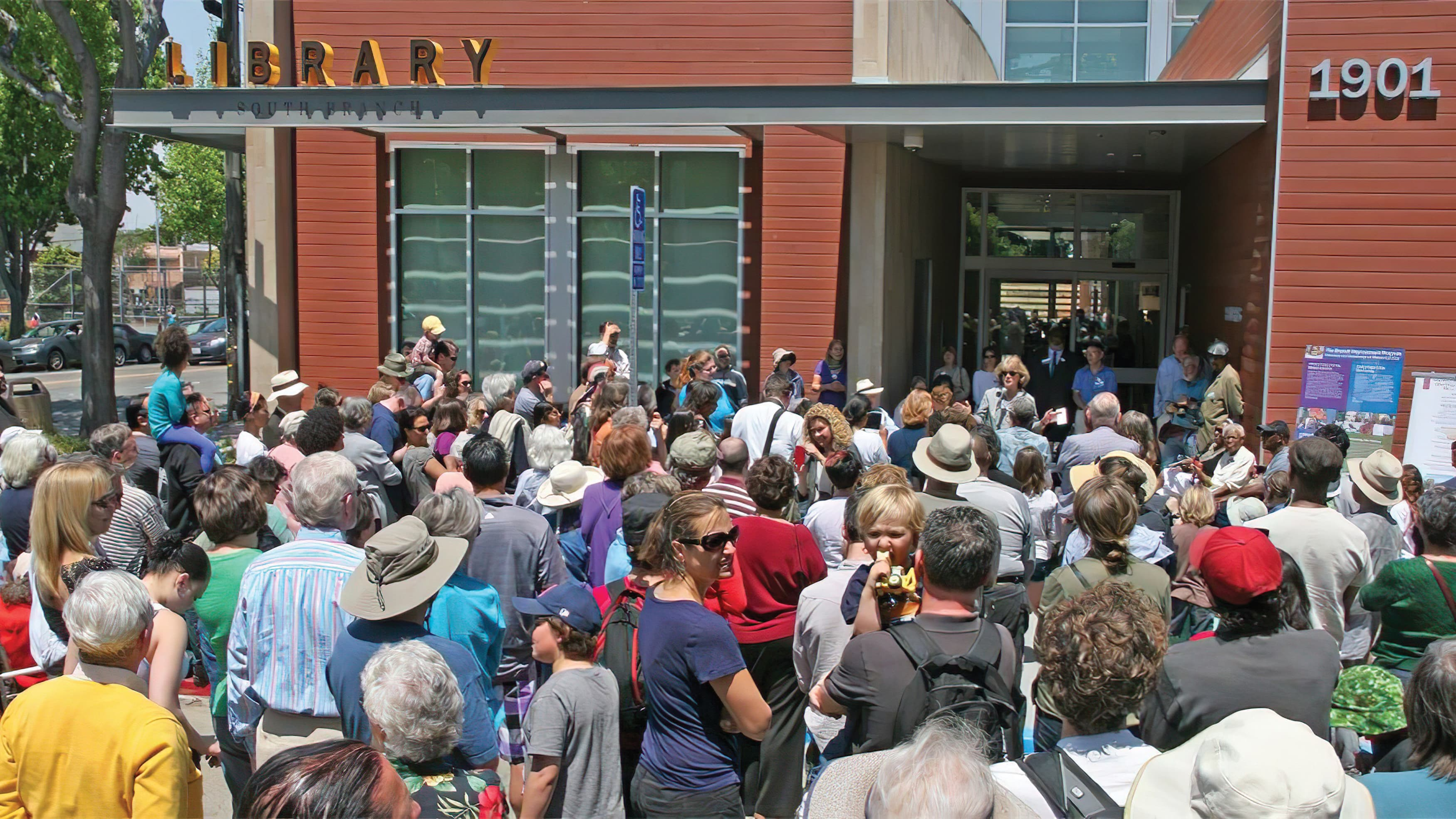 People gather in front of South Berkeley Library branch grand opening