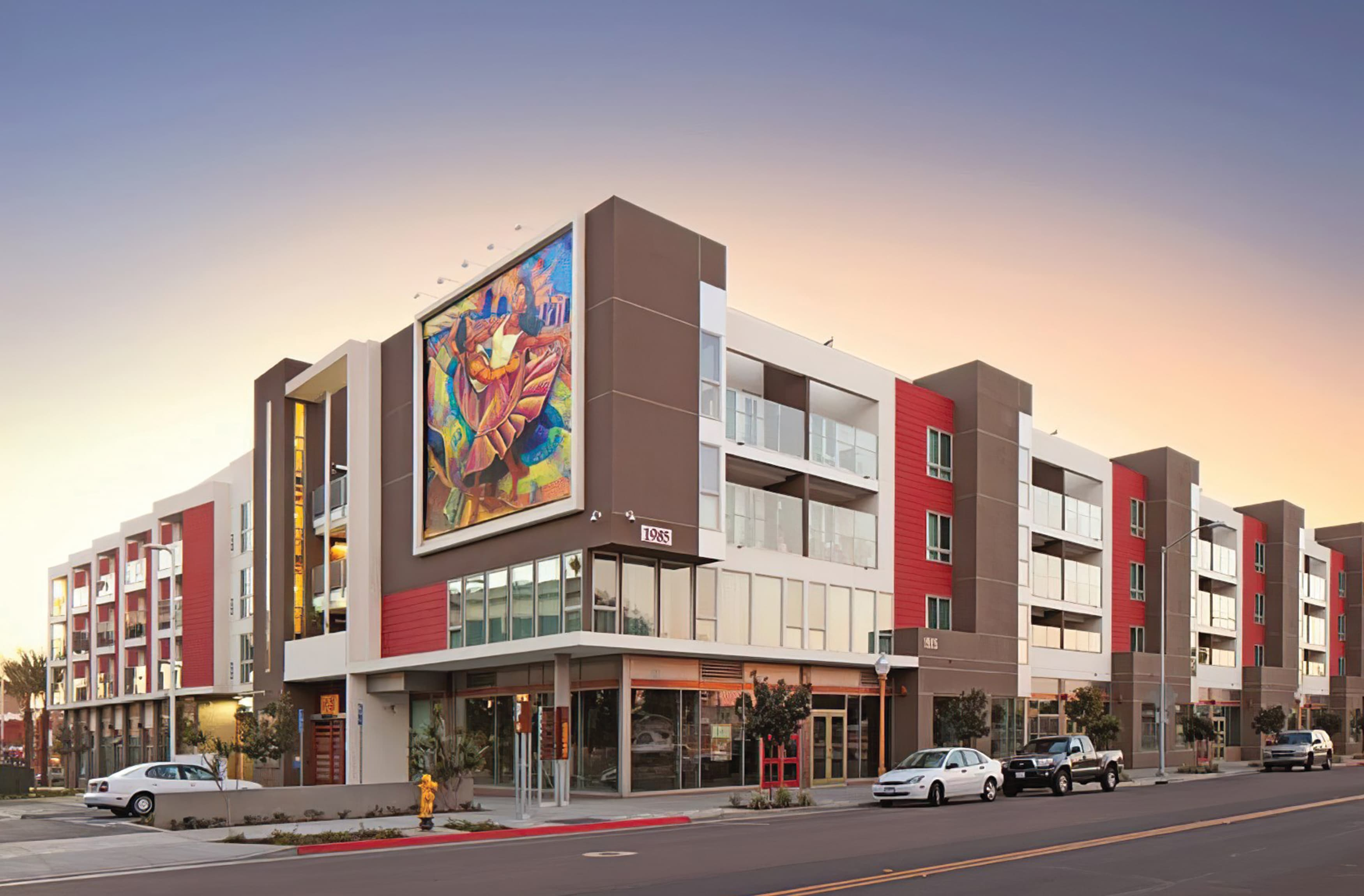 A photograph of a mixed-use residential and retail building located at Barrio Logan in San Diego, CA.