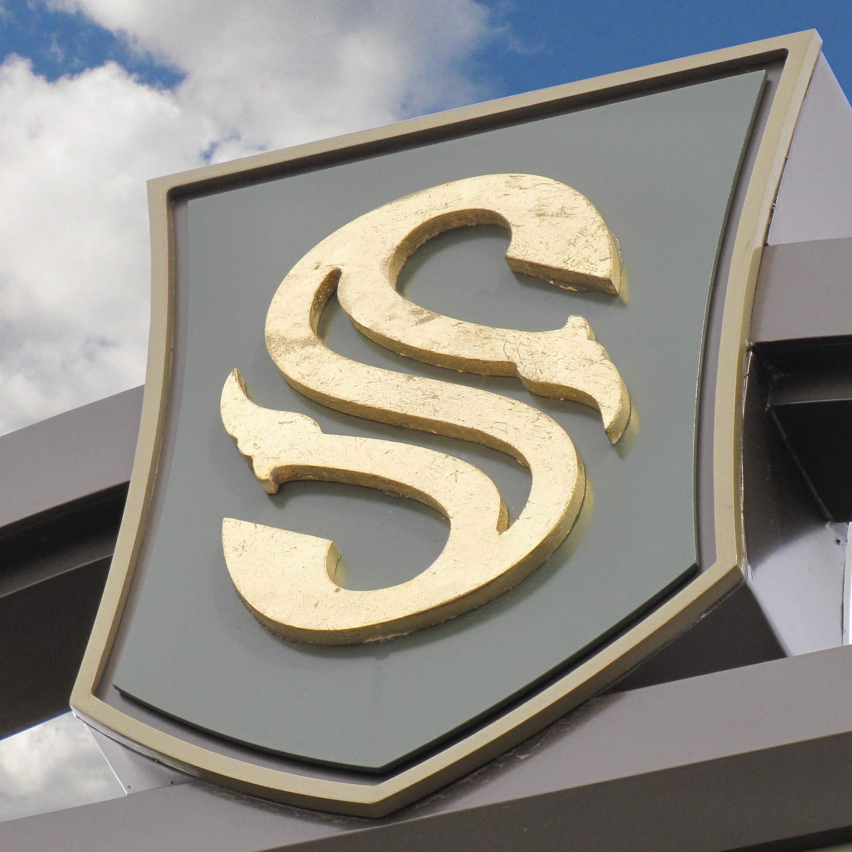 A close-up photo of the S mark of the City of Southlake applied to a sign.