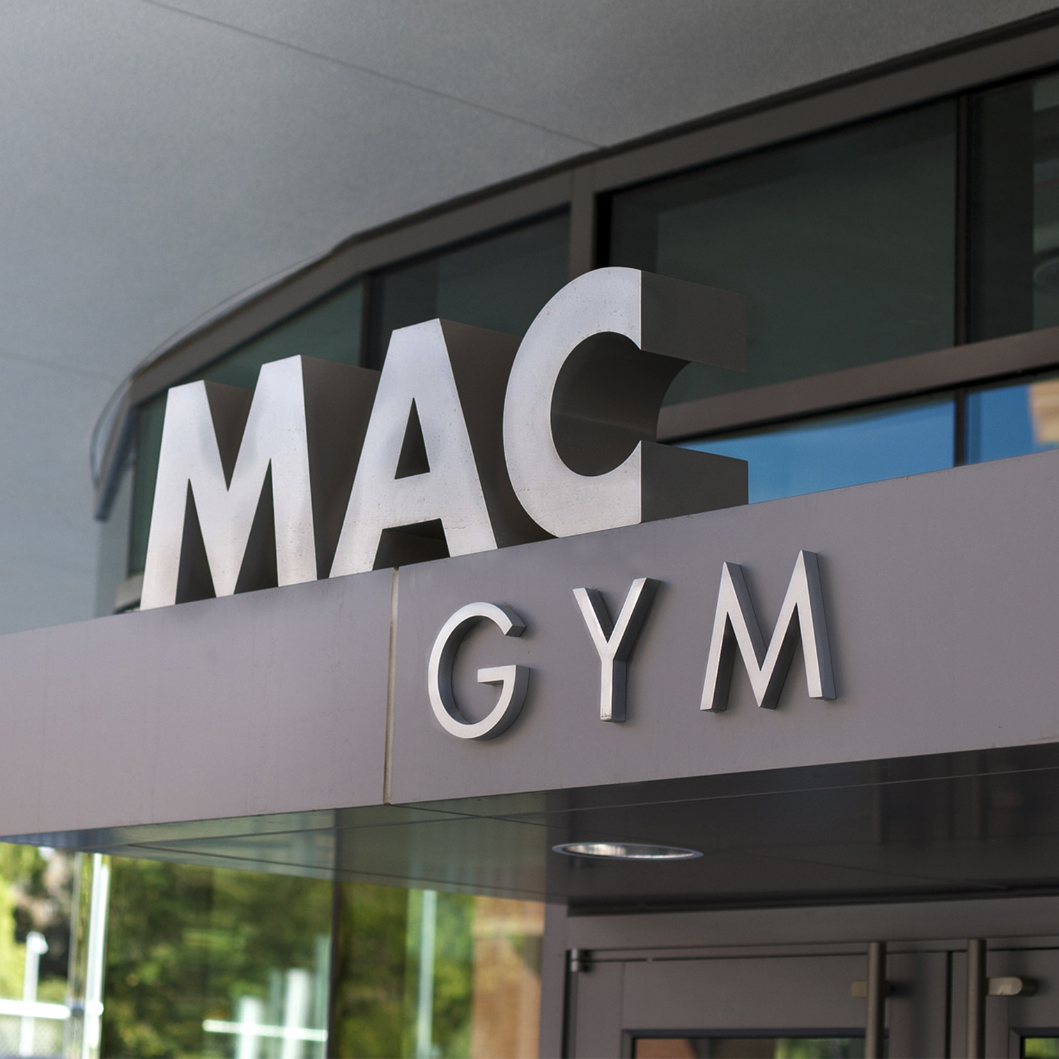 Close up detail of an Entrance sign for Gym at a University