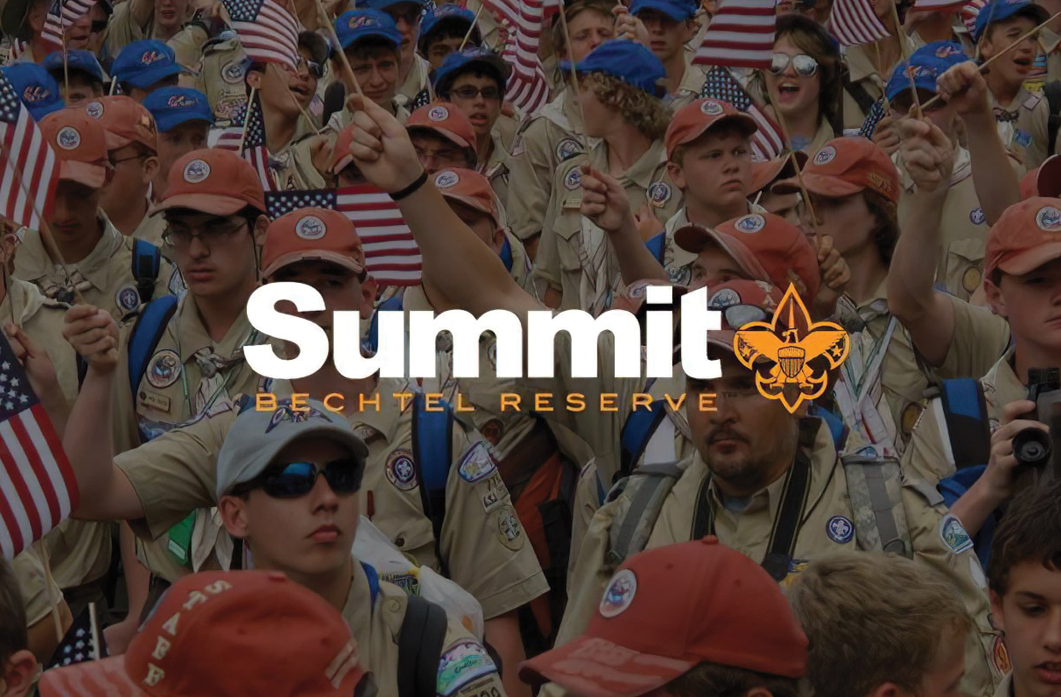 The logo for Summit Bechtel Reserve overlaid on an image of Scouts with American flags.