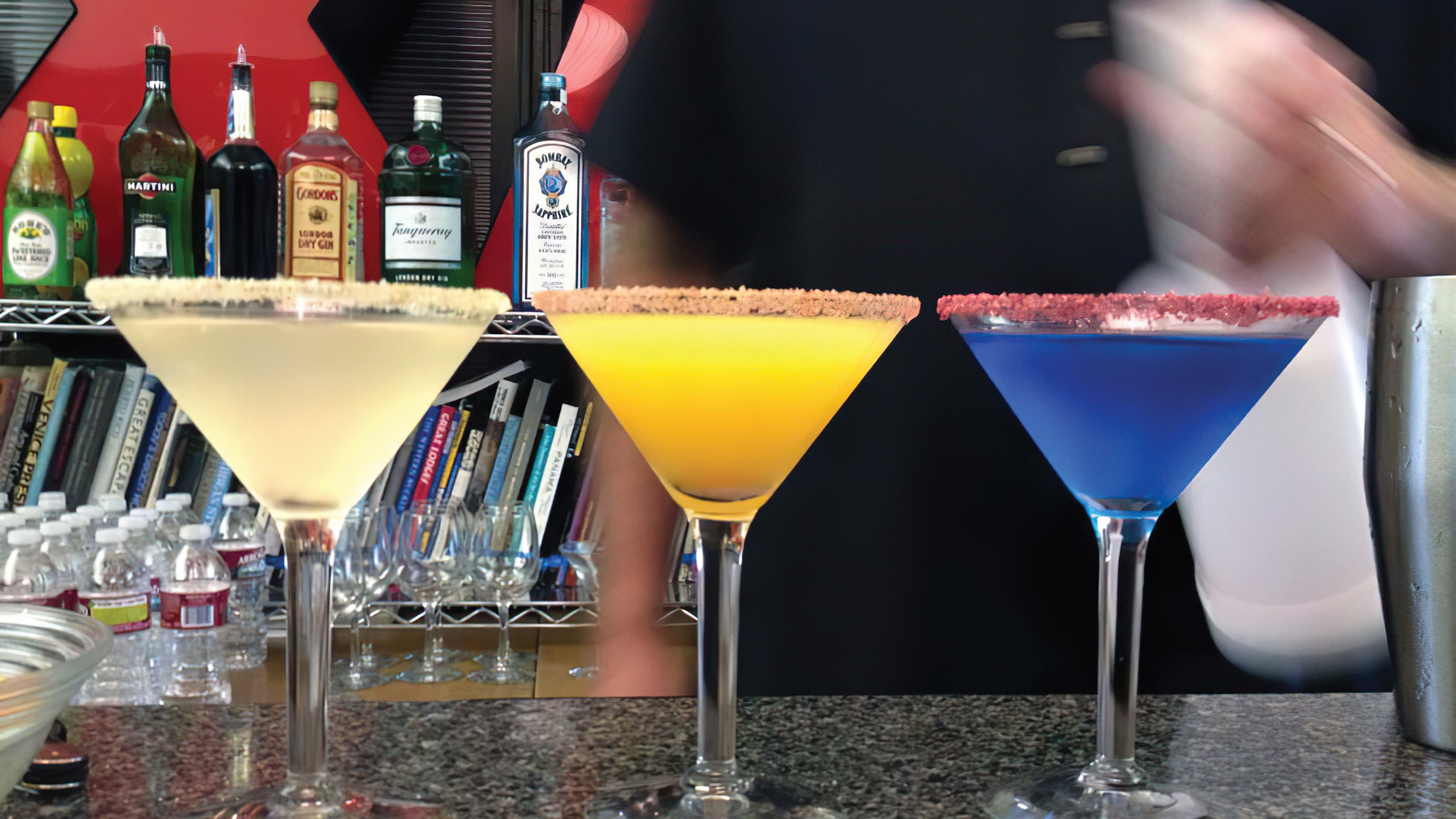 Three martini glasses with differenly colored drinks, poured in celebration of RSM's 15th year in business.