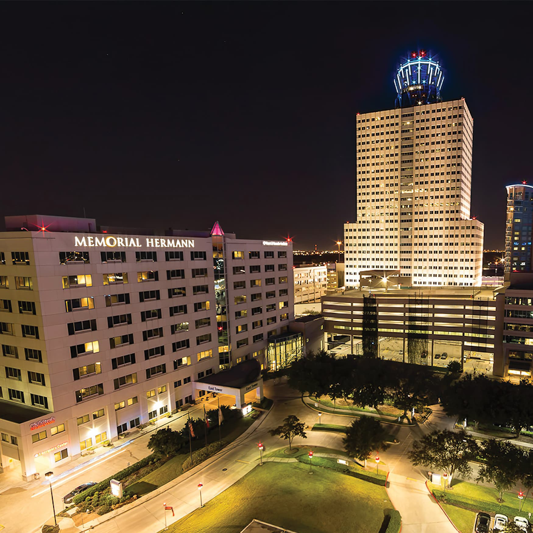 A nighttime photograph of the Memorial Hermann campus.