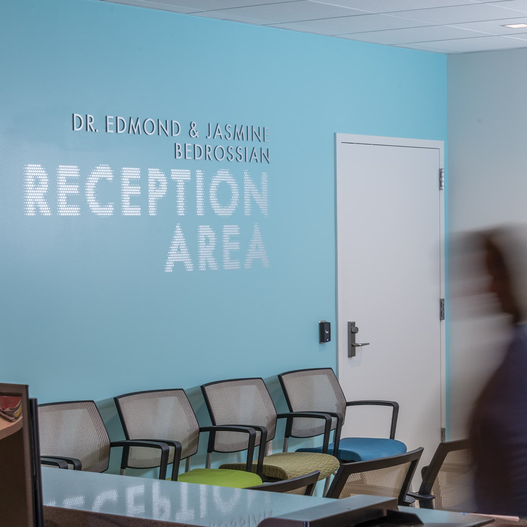 A photograph of wall signage in the reception area at the University of the Pacific Dental Care Center in San Francisco, CA.