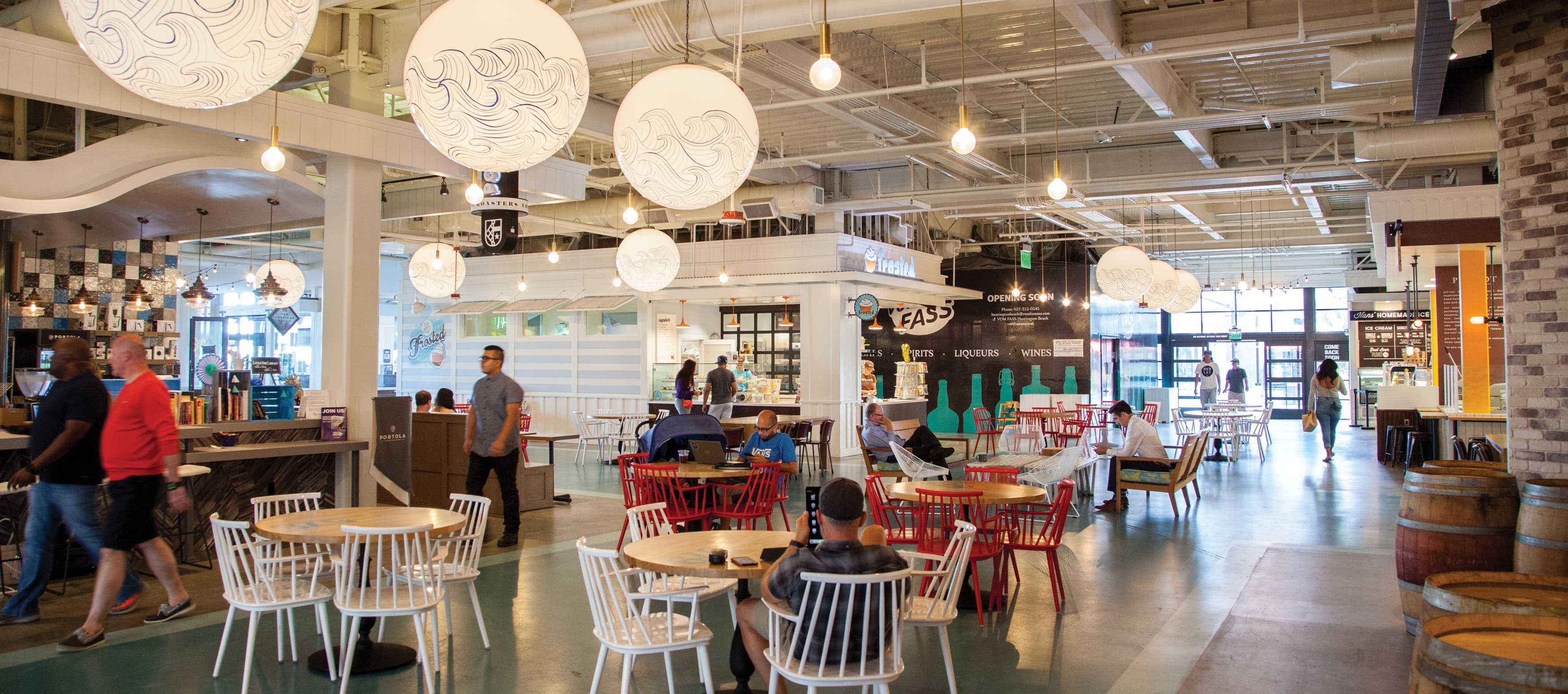 Interior of foodhall with people eating inside